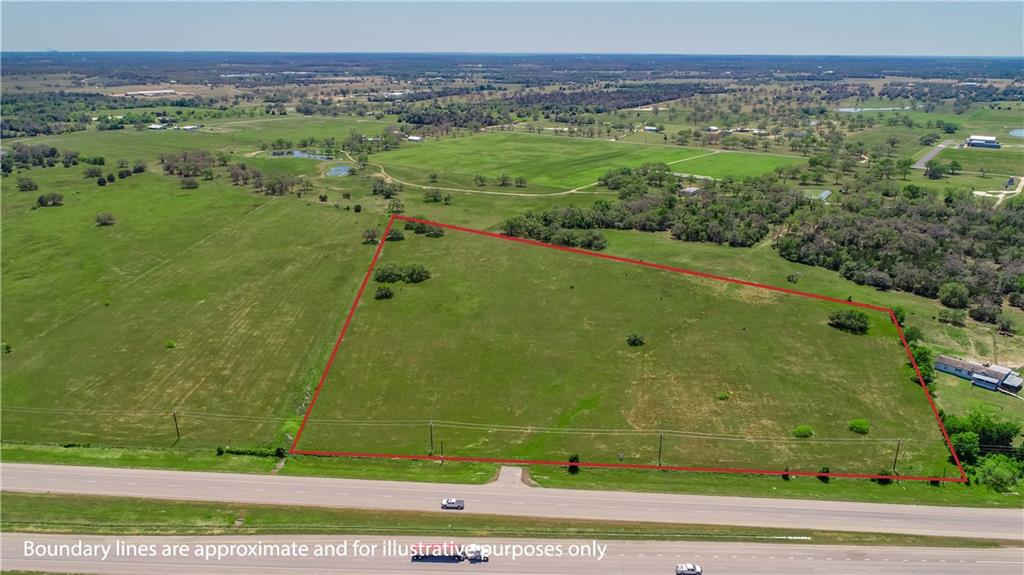 13.810 Acres with approx. 656' of Highway 290 Road Frontage and existing entrance going eastbound outside the Giddings city limits. Open pasture, fenced on 3 sides, mostly flat with a few scattered oak trees towards the back of the property. Bluebonnet Electric power and Lee County Water Supply lines run along the front of the property paralleling Hwy 290 E. No zoning or restrictions. Great commercial potential here!