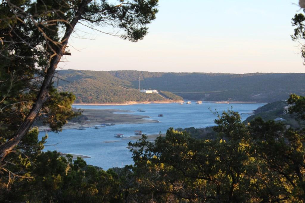 53.17-Acres; some Lake Travis cove frontage; Current City of Jonestown Zoning single family SF-1. Guy Star Mountain; a Scenic Hilltop with expansive Views of Lake Travis and the hill country. Highway 1431 frontage, plus West Rim Dr and Guy Mountain Dr traverse through the property. Mostly un-platted acreage plus 7-platted Lots. Jonestown Water Supply Corp water lines along west side of property and also to property edge at West Rim Dr.  Public boat launch ramps 5-minutes away at Jones Brothers city parkRestrictions: Yes