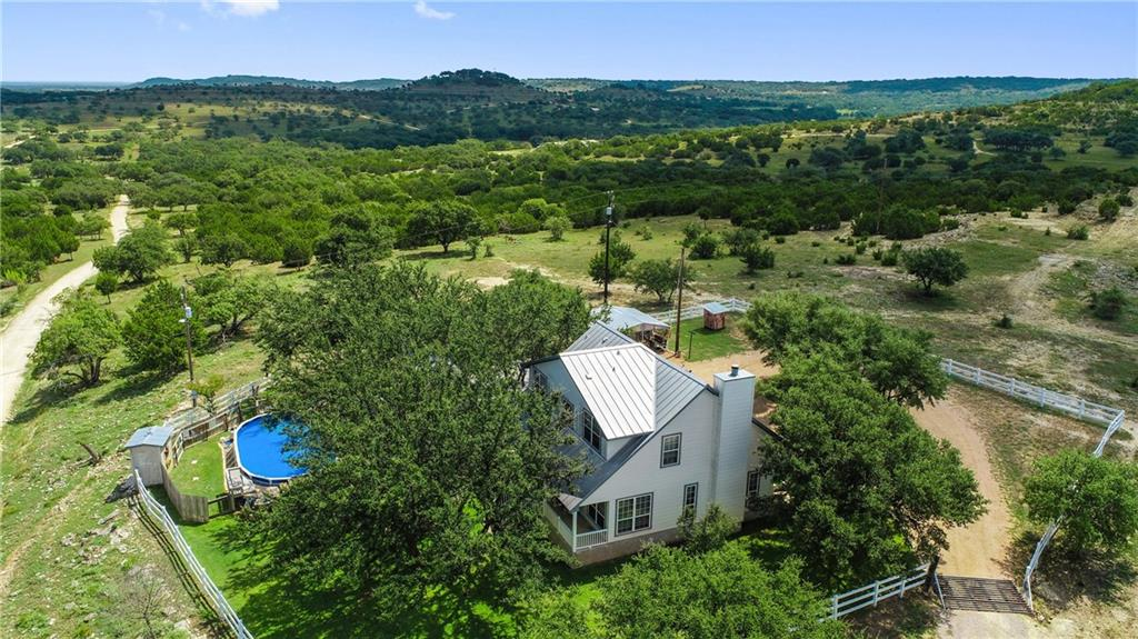 50+/-  Unrestricted Acres W/ many uses.  W/Home, Pool, Barn w/living quarters & Monster Views!  Main house 1818 SF 3BR/2BA w/front & back porches, 2 car carport & beautiful back yard.  Pool w/deck & 432 SF pool house w/water closet & loft. Views from the Pool! 240 SF Mancave w/workout room, shop & greenhouse. 200 SF storeroom with shed for golf carts/utility vehicles. Huge 12,000 SF metal barn w/ 2368 SF two story barndominium w/ 6BR/2BA. Huge deck off 2nd story, inside barn for storage.FEMA - Unknown Guest Accommodations: Yes Restrictions: Unknown