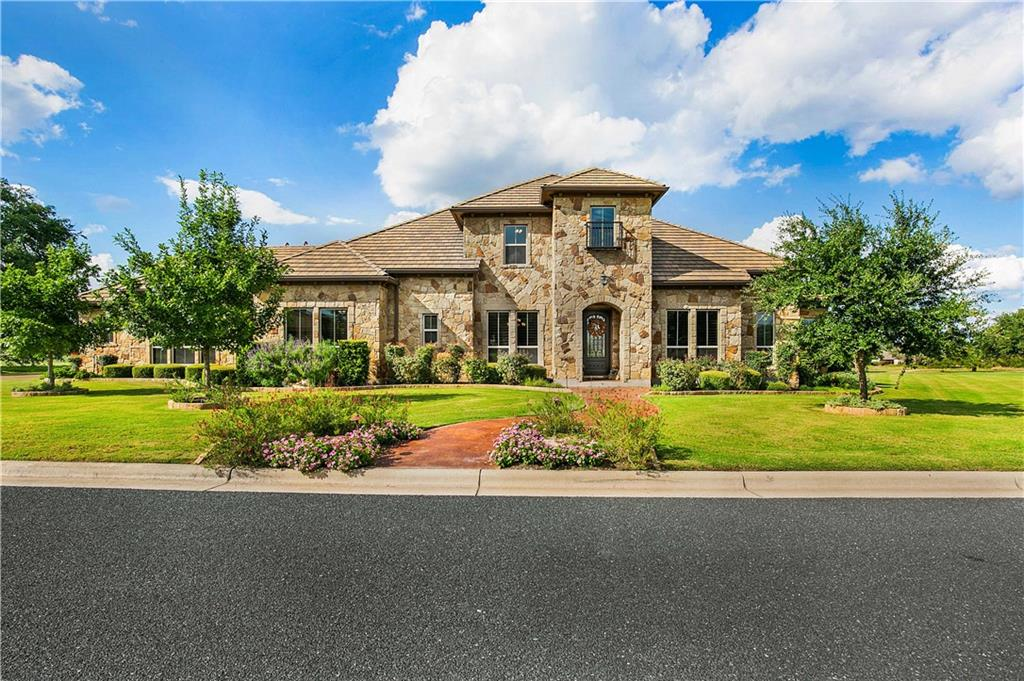 Immaculate custom home nestled on the 14th fairway of Cimarron Hills Golf and Country Club.  This custom masterpiece has a spectacular panoramic view of the golf course and hill country. Enjoy entertaining guests on the covered outdoor patio, outdoor kitchen grill and fireplace, along with a separate sitting area with a fire pit, coupled with a beautiful fairway view. This custom home is decorated with hardwood floors, ceramic tile, decorative lighting, vaulted cedar beamed ceilings, and tons of upgrades, including remote shades and plantation shutters.  The primary bedroom has a gorgeous view of the golf course, dual vanities, an enormous walk in shower with dual shower heads, his and her closets, and a huge garden tub.  Each bedroom is equipped with a full private bath, formal dining has a butler bar and grand built-ins. Upstairs has an enormous media room/game room with full bar, upstairs bedroom and full bath, and a balcony overlooking the beautiful golf course and hill country views.  The oversized garage is equipped with built in cabinets and storage, along with plenty of space for a golf cart.  Every detail of this home is stunning, along with the preferred tax difference for this section of Cimarron Hills!  A must see!
