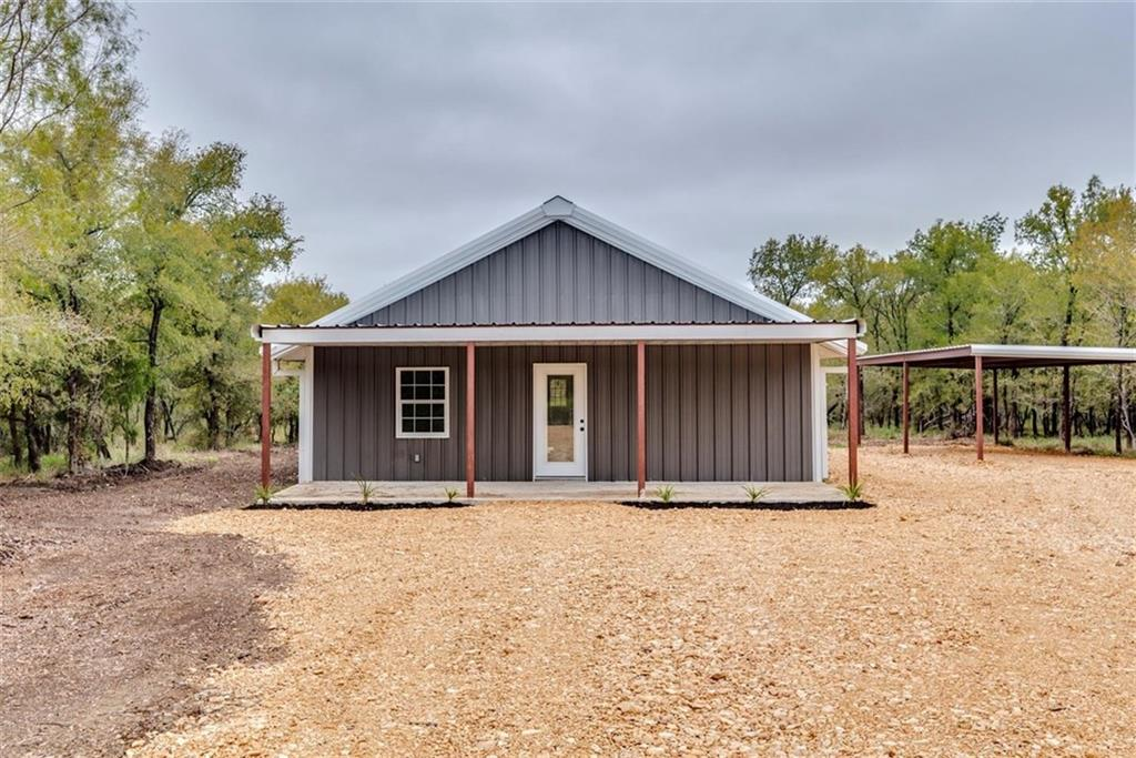 Tucked away in the woods! Stunning NEW custom built home on 12.12 acres off FM 812. Beautifully-designed open concept home features a farmhouse style kitchen, granite countertops, onyx concrete flooring, wood finished ceilings/trim, and recessed lighting. Covered back/front patio & carport. Enjoy endless outdoor activites that you can't do in a neighborhood! Property is heavily wooded but can be cleared out to build a workshop, pond, or second home. No HOA. Low taxes.Restrictions: Yes