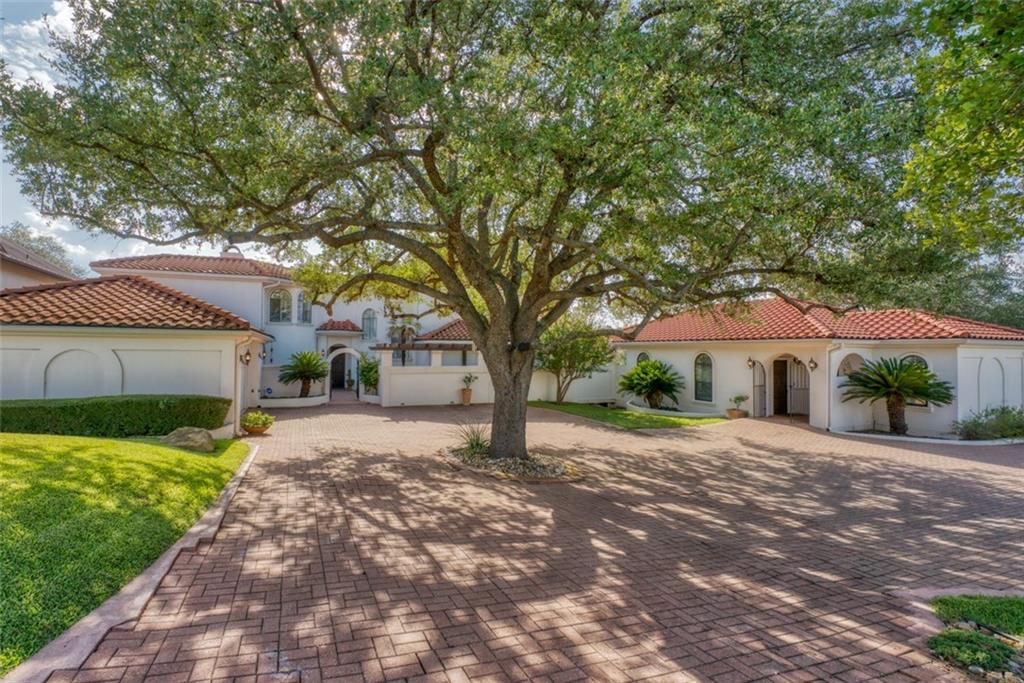 ELEGANT SPANISH STYLE HOME with a CASITA surrounded by MAGNIFICENT TREES. This Applehead home is ideal for entertaining, offers a private guest casita, generous parking, welcoming courtyard and flows well from the island kitchen, family room,dining room, large open living room with soaring ceiling and multiple windows, wet bar, powder room, and multiple patios to enjoy the outdoors and gorgeous views of the trees. Pella doors are installed for easy access to the patios. Speakers are installed for enjoying your favorite music, fireplaces in the family room and living room have gas starters. The main house features 3 bedrooms each with private bathrooms and patio access with views. The home is by Apple Rock Golf Course #3 and has a live creek behind the property.The 860 sq ft casita was built in 2009 and is handicap accessible. It features 1 bedroom, 1 bathroom, 1 half bath, spacious living room,kitchen with breakfast bar and a covered patio to enjoy the beautiful view of the trees--a true luxury for family members and guests with extended visits. The home and separate casita sit on almost 3/4 of an acre and the property is partially fenced with a wrought iron fence.All appliances in the main house and casita are included. Applehead owners can enjoy the Applehead POA swimming pool, tennis courts and pavilion which are only 0.2 miles away. An Initiation Fee Waiver to join The Club At Horseshoe Bay Resort is available (upon approval and acceptance by The Club At Horseshoe Bay Resort).