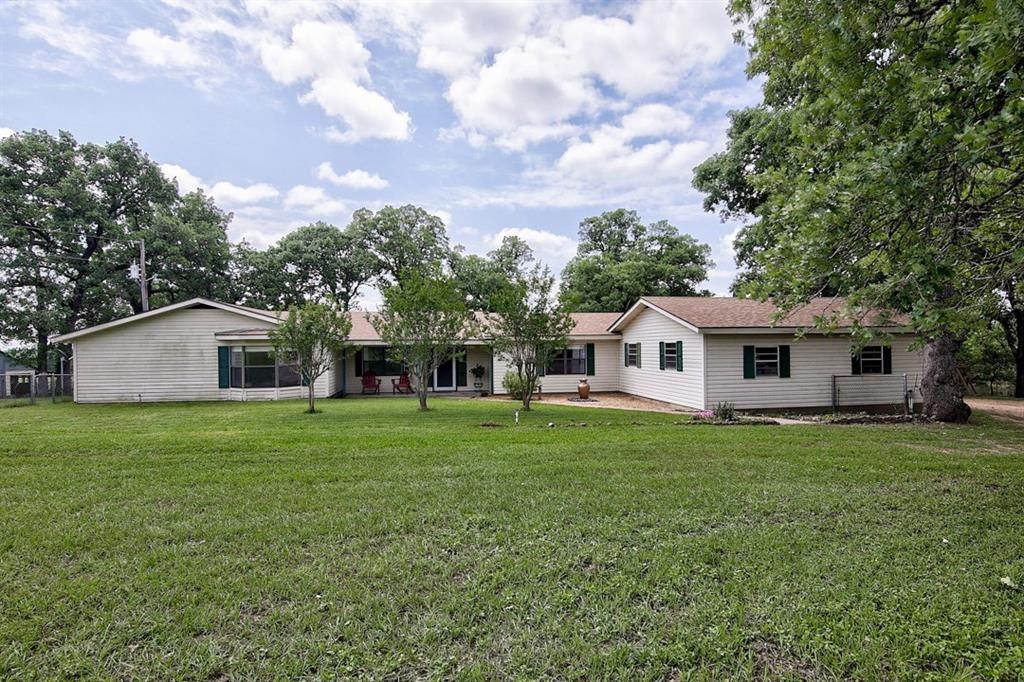 Turn-Key Country Property! This is the perfect combination of peaceful country living and outdoor adventures. Spacious home, abundant natural lighting, remodeled interior, large kitchen, dining, and living areas, & master suite to fall in love with! Additionally, there is a covered outdoor entertaining area with a view of the nearby ponds. Outbuildings include a large workshop/garage/storage building, a chicken coop, workshop, equipment shed & covered RV parking. High fenced area for breeding deer!