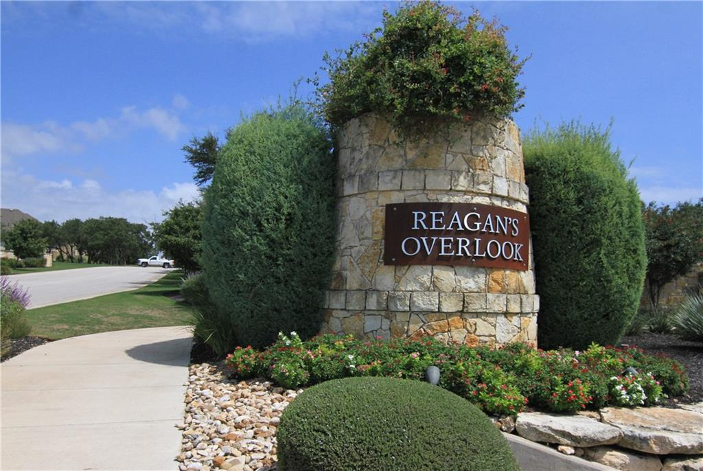 """Reagan's Overlook,beautiful stately hill country community. 1 acre home site, 4 sides stone, lovely landscaping and  trees. Covered front porch host dual entries via french doors entering formal dinning or through 8' Mahogany front door, to beautiful hardwood floors, 10' ceilings, crown molding, rounded corner, entertainment center, stone direct vent fireplace, professional interior design & window treatments, spacious living, dinning, & kitchen built for entertaining. Large office with hard wood floors, french doors and plantation shutters. Kitchen host granite counters, eat at bar, barn sink with stainless steel faucet, 42"""" cabinets, pot drawers under cook top, large capacity stainless steel oven, built in microwave, eye catching 16 X 16 tile back splash, recessed lighting, large pantry and large breakfast area looking out over the back yard.  The private owners suite features a large bedroom with sitting area overlooking back yard.  Enter the luxurious owners spa bath, soaking tub for two, enclosed frame glass walk through shower for two, massive granite counter dual vanities, under mount sinks, with ample storage space, wall to wall mirror, private water closet and linen closet, his and her walk in closets, one entering into the laundry room. Separate wing of house features over sized secondary bedrooms, walk in closets, jack-n-jill bath and a private half bath with pedestal sink. Bring the outside in flow through a wall of sliding doors onto over-sized covered porch, vaulted bead board ceilings, w/wood burning fireplace, broom finish flat-work, outdoor kitchen access to the expansive private backyard with trees, room for a pool, only limited by imagination.  LEED certified from U.S. Green Building, LowE-3 insulated windows, fresh air intake to circulate air, attic ventilation, radiant barrier, High efficiency HVAC 16 seer, R-13 walls, R38 in attic, dual 40 gallon hot water heaters."""