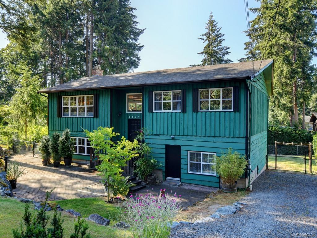 Main and Lower Entries. Westcoast style with solid wood siding. Roof only 7 years old