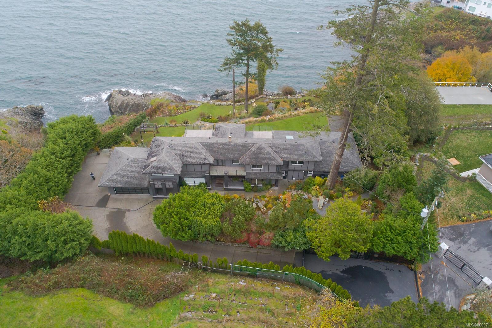 One of the finest oceanfront estates found in Victoria today, on a private 1.16 acre low bank waterfront. This whooping 6400 sq ft custom home is newly renovated and only minutes to UVIC, downtown and all amenities. This property offers 8 BRs, 7 baths, and 3 kitchens, ideal for guest quarters or extended family. The main floor includes spacious LR with floor to ceiling windows, modern fireplaces, formal dining room and 5 sundrenched decks all overlooking the ocean view. The gourmet kitchen with white quartz countertops, dual breakfast bars and top end appliances are sure to please. Upstairs you will love the spacious master suite with his & her walk in closets, jacuzzi ensuite, large bay windows & deck to showcase the views. The lowest floor includes 3 BRs, spacious living area, large indoor hot tub and separate sauna with a 3 car garage. You will enjoy the meticulous landscaping with a waterfall, lighting and irrigation system throughout the gardens, and paths to the ocean. Call Now!