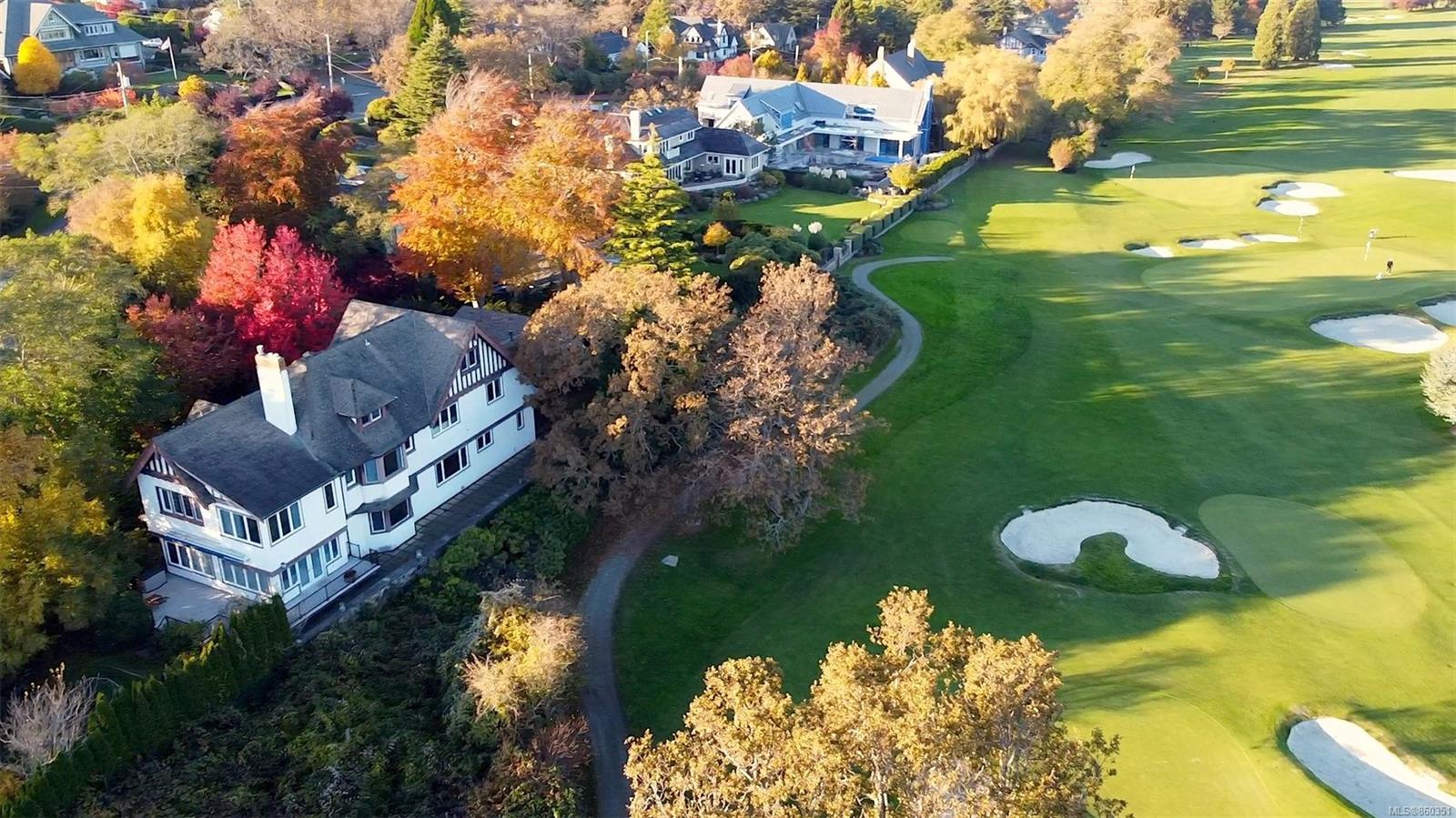 A private sanctuary of Character, Timeless Elegance & the most stunning full sun locations; one of a handful of exclusive homes that border the Victoria Golf Course (founded 1893) w/water views from Mt. Baker to the Olympic Mtns. Private & completely hidden from view, find this Samuel MacLure 1911-7,164 SqFt, 4/5 BR, 5 BA, 5 FP home on 3 levels of quality family living. Many upgrades of which the ELEVATOR, foundation, drainage, wiring, thermo windows, gas fireplaces & heat pump are among the highlights/all done during a major 2004 meticulous renovation balanced w/glossy hardwood flrs, leaded windows (full storms) coffered Ceilings & grand proportions rarely seen in contemporary homes. Combine this w/an Architecturally sensitive addition of Family Rm & 2 Car Garage with automated entry & the result is a, stunning home on a beautiful lot overlooking the quintessential S Oak Bay View. All necessities are within 10 minutes & the Seaside Village of Oak Bay is within easy walking distance.