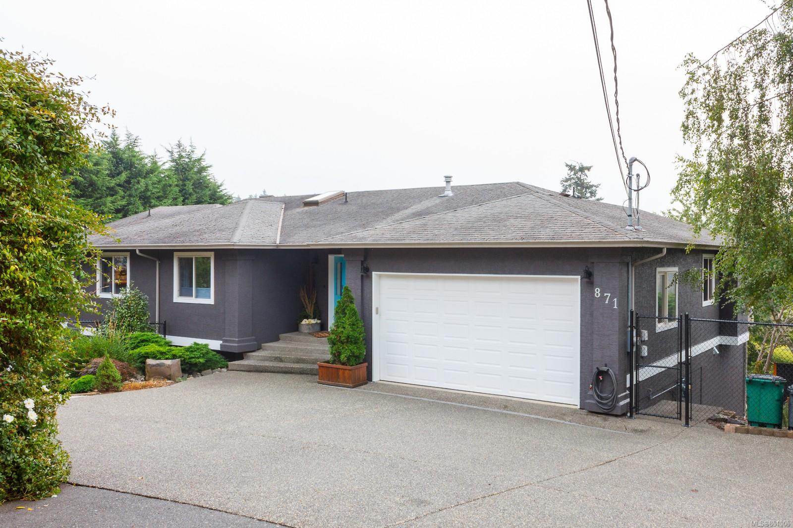 Beautiful, spacious home has been stylishly updated throughout, offering great flexibility with a versatile layout. The main floor offers complete living on one level, with master and ensuite, 2 more bedrooms and full bath, plus kitchen, dining, family and living rooms (each w/ gas fireplaces and connected with gorgeous white oak wide plank flooring). Expansive view over Rithet's Bog and Olympic Mountains. Stainless steel appliances, gas range, quartz counters, under-mount sink complete the remodelled kitchen. The lower level offers huge flexibility with an additional full living space directly connected to the main level, ideal for extended family, kids, your home office, or for use as a revenue suite. There is a gorgeous, independent and fully equipped 2-bedroom suite. This is a very private, fully fenced 1/3 acre lot with a separate dog/kid play zone with artificial turf, and 2 sheds. Excellent school district, easy walk to shopping, buses and more.