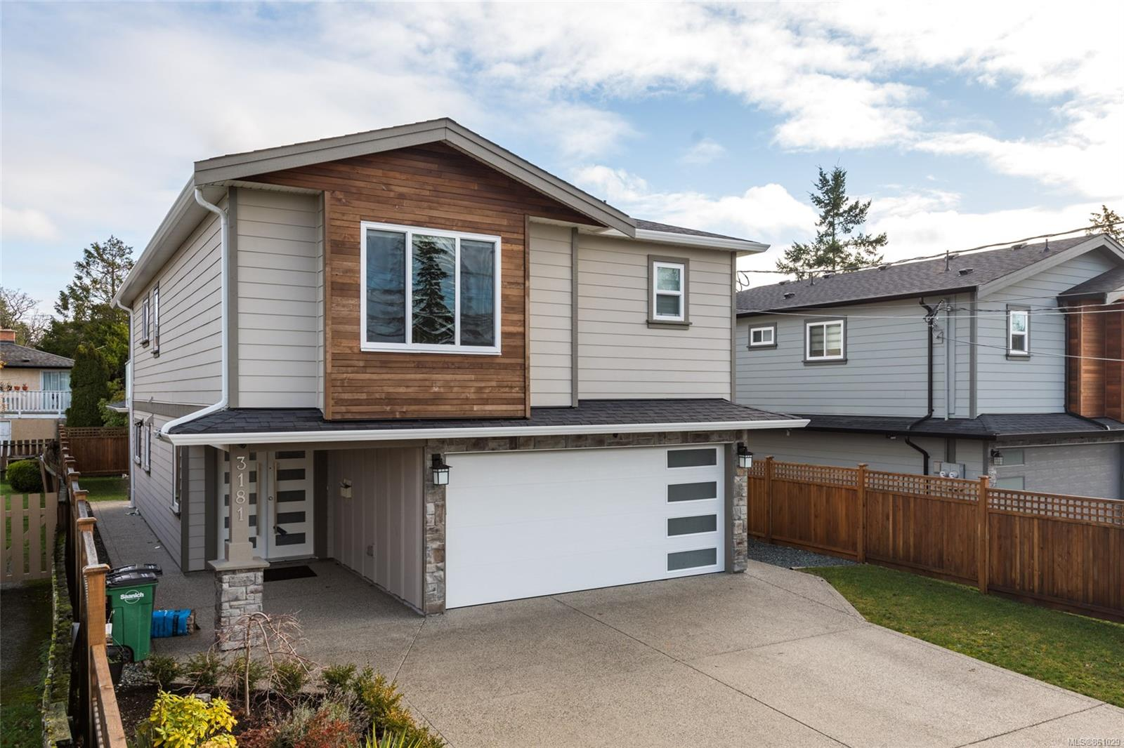 Located on an extremely quiet, one-block-long side street, close & convenient to Camosun College & UVIC, you will find this large near new home. You'll love the large bedrooms in the main home with quality details such as quartz counters, rich wood flooring, crown mouldings, stainless steel appliances, custom LED lighting, and a heat pump for efficient heating and cooling. Enjoy the ultimate in mortgage helpers here with the large, above ground, no-step suite on the ground level, plus a fully detached studio. Live here inexpensively while others pay your mortgage, or simply enjoy this home as a great investment property. No GST!