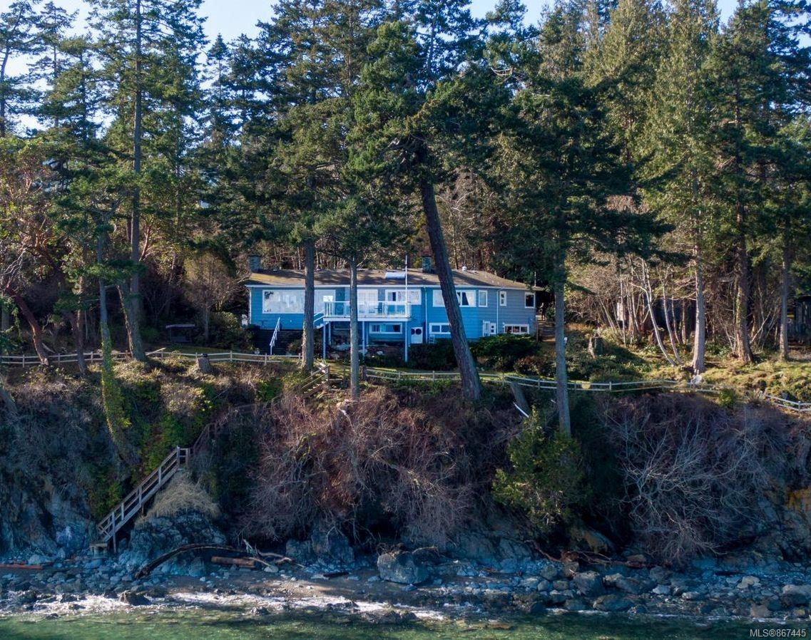 Rarely does a property so spectacular come to market! Sitting on 1.05 acres, this tranquil and secluded parklike setting offers complete privacy, while being right in the heart of Cordova Bay. Offering over 220 feet of oceanfront, remarkable unobstructed views of Mt. Baker and the Gulf Islands, and private access to a sandy walk-on beach, this exemplary property is a must see! With its solid layout and large windows framing the surrounding natural beauty, the home provides 3 bedrooms upstairs, and a large suite on the lower level. Outside, the incredible 21x21-foot deck is an ideal spot for watching marine life, delivering the ultimate West Coast lifestyle. This breath-taking oceanfront property would make a wonderful West Coast retreat or an income-generating investment with tremendous potential.  A natures paradise worth calling home.