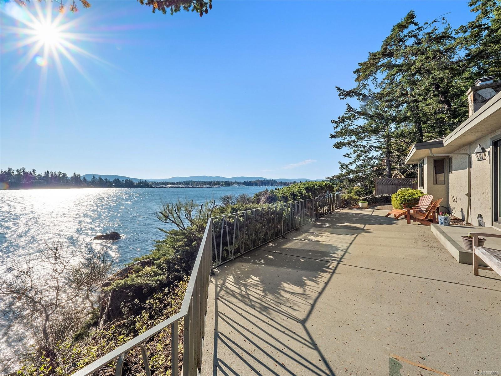 South facing waterfront home on .55 private treed acres. Live amongst the best of west coast life on the water here on exclusive Curteis Point. One level living is possible here in this hybrid mid century mod style home with views and exposure to live for! Your private estate lot begins as you drive through an array of mature Douglas Fir, Cedar and Arbutus trees to the home site which offers an oversized detached garage and the main house. 3 Bed, 3 Bath with an updated kitchen with heated tile floors & new Pella doors to the 675 sqft waterfront patio. A gas fireplace anchors the open living plan in addition to a flexible layout that offers 2 or 3 bedrooms on the main and another on the lower walkout level. A new staircase to a private arbutus cove is a great spot to launch your kayak/paddle boards to explore the surrounding smaller Islands.  Year round moorage is available at the many choices of walkable marinas nearby. Don't wait too long, private South facing waterfront is rare!