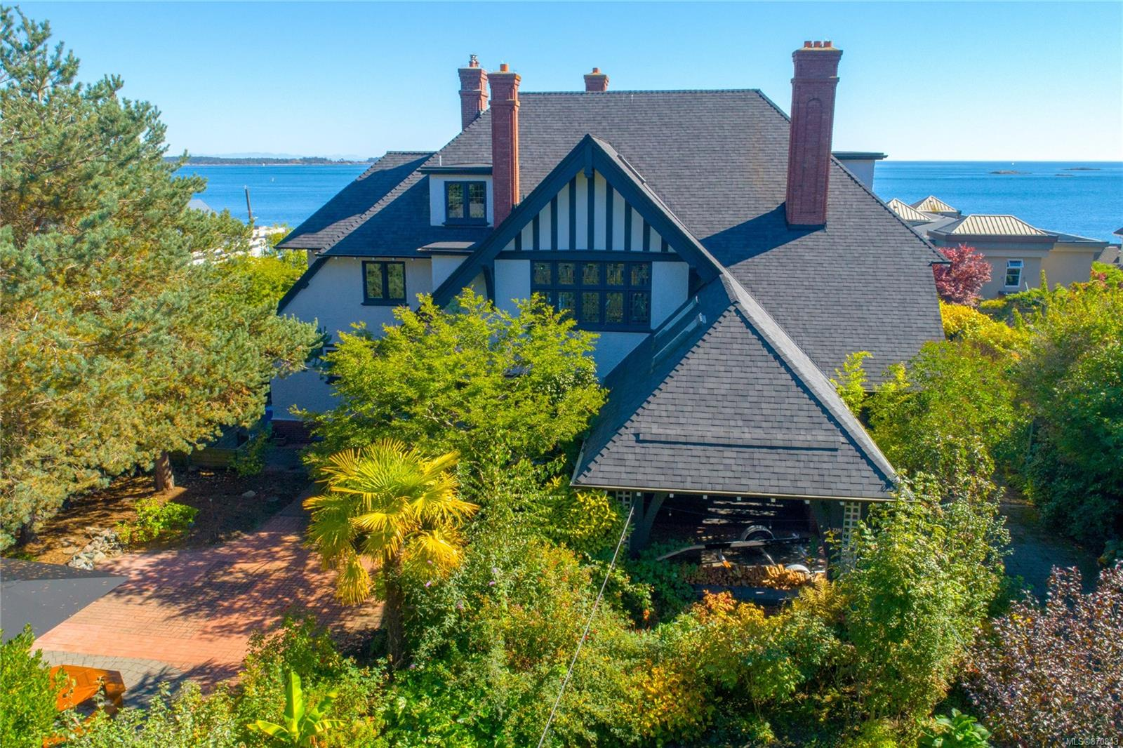 If you've ever dreamt of living in an amazing manor, in an excellent neighbourhood; here's your chance. The Finlayson home at 2391 Beach Dr. is one of renowned Samuel Maclures finest and most personal architectural statements. It was the last of his famous Arts and Craft builds in 1914/15  The past five owners have taken extremely good care of the home but none like the current owner who has spared no expense in making sure this homes legacy will live on. The extensive list of work that has been done is available. The well known designer, Brian Paquette was commissioned to decorate and modernize the home while keeping many of the very elaborate original light fixtures, hardware, window screens, fireplaces & screens etc. With all the modern conveniences and healthy attributes; it simply must be seen to fully appreciate how comfortable this old masterpiece is. Ideally located near to Willows Beach, Estevan Village, Glenlyon Norfork School, Oak Bay Ave, Oak Bay Marina &, RV Golf Course.