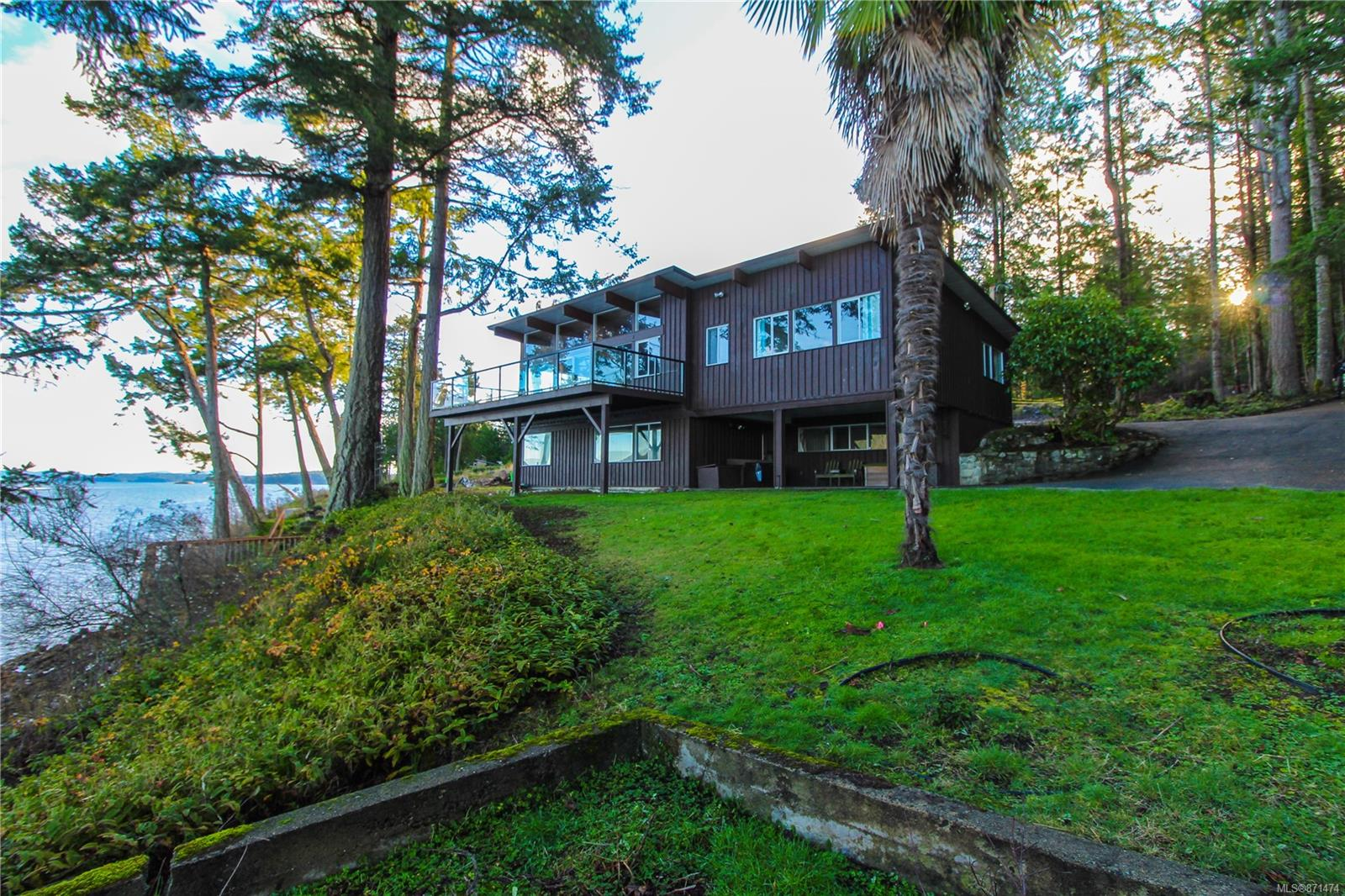 Wake up to a beautiful Ocean view over Satellite Channel with over 114 ft of waterfront. Looking right across to Mount Tuam on Salt Spring Island this North Saanich location has steps down to the beach, a boathouse renovated in 2017, and its own mooring buoy! With 2/3 of an acre, a large deck and close-up view of the Ocean this house offers a great opportunity to get on the beach in the best place in Canada . Open concept with vaulted ceilings, there are Ocean views from the majority of the interior of the home. Primary bedroom with ensuite is on the main floor, with an additional bedroom and den on the lower floor, both have a beautiful ocean view. Perfect spot to raise a family, tons of space and endless fun to be had on the beach. With Victoria's competitive market, this is a rare opportunity to buy your dream home, don't hesitate!