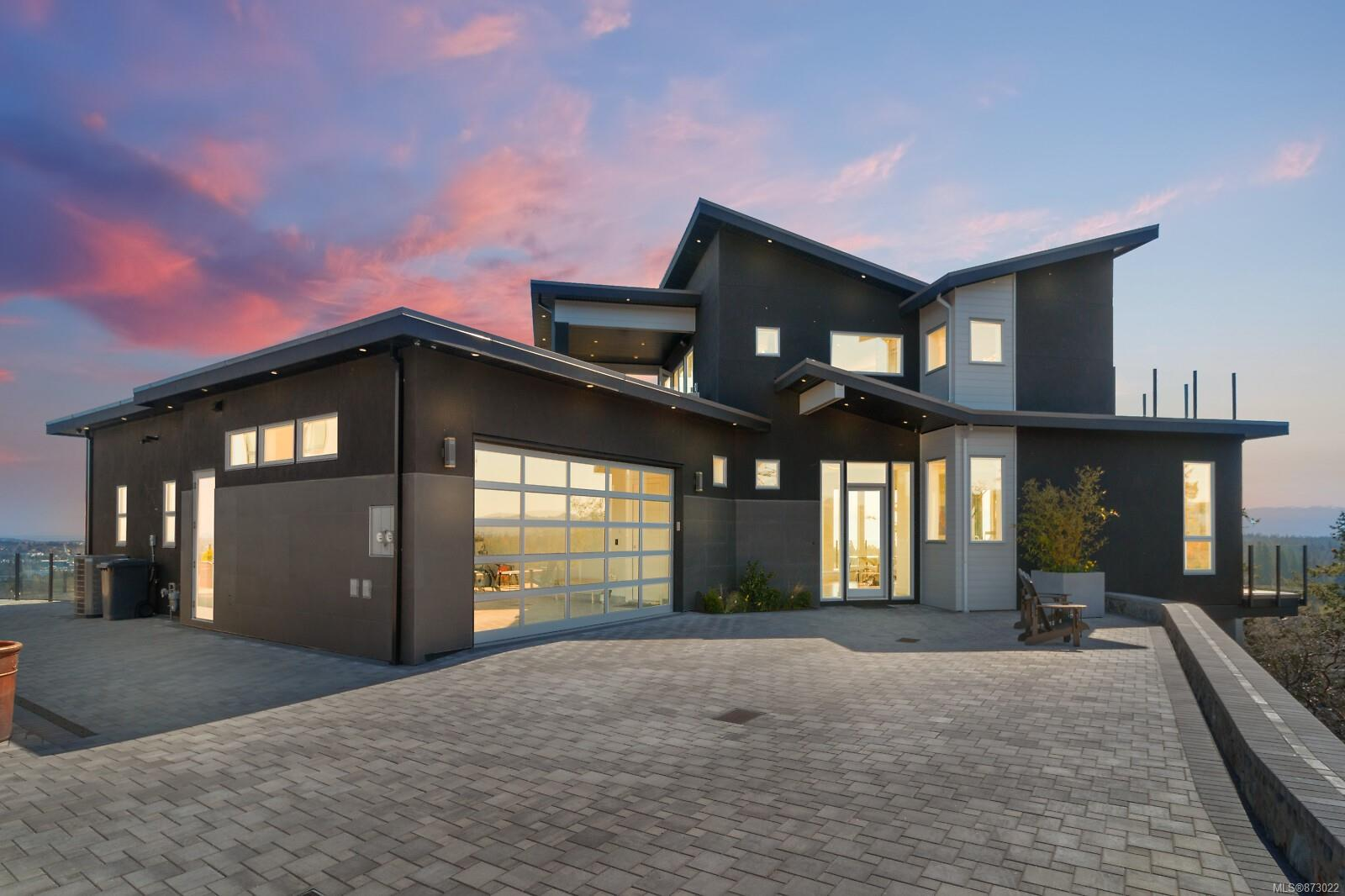 Indulge yourself! Truly one of the finest homes & locations found in Victoria BC Canada! Imagine breathtaking 360 degree views of the ocean, Mt Baker and the twinkling city lights of Victoria. Enjoy your exquisite 2018 custom home with soaring 12 ft ceilings, floor to ceiling windows, imagine 5600 sq ft of luxury living offering the ultimate gourmet kitchen with quartz countertops, oversized breakfast bar and large walk-in pantry. Enjoy the ultimate dining experience with your inline DR and LR all designed with world class views. Spacious master on the main floor to fall asleep watching the sparkling city lights of Victoria. Pamper yourself with a luxury ensuite w/oversized tiled shower & deep soaker tub. The upstairs sky bar rec room with wrap around windows overlooking the entire S. Vancouver island, outdoor, covered BBQ centre and 2900 sq ft of deck and patios to showcase the amazing views!. Full lower level with theatre room and more .66 acre, new home warranty and no GST. Call now