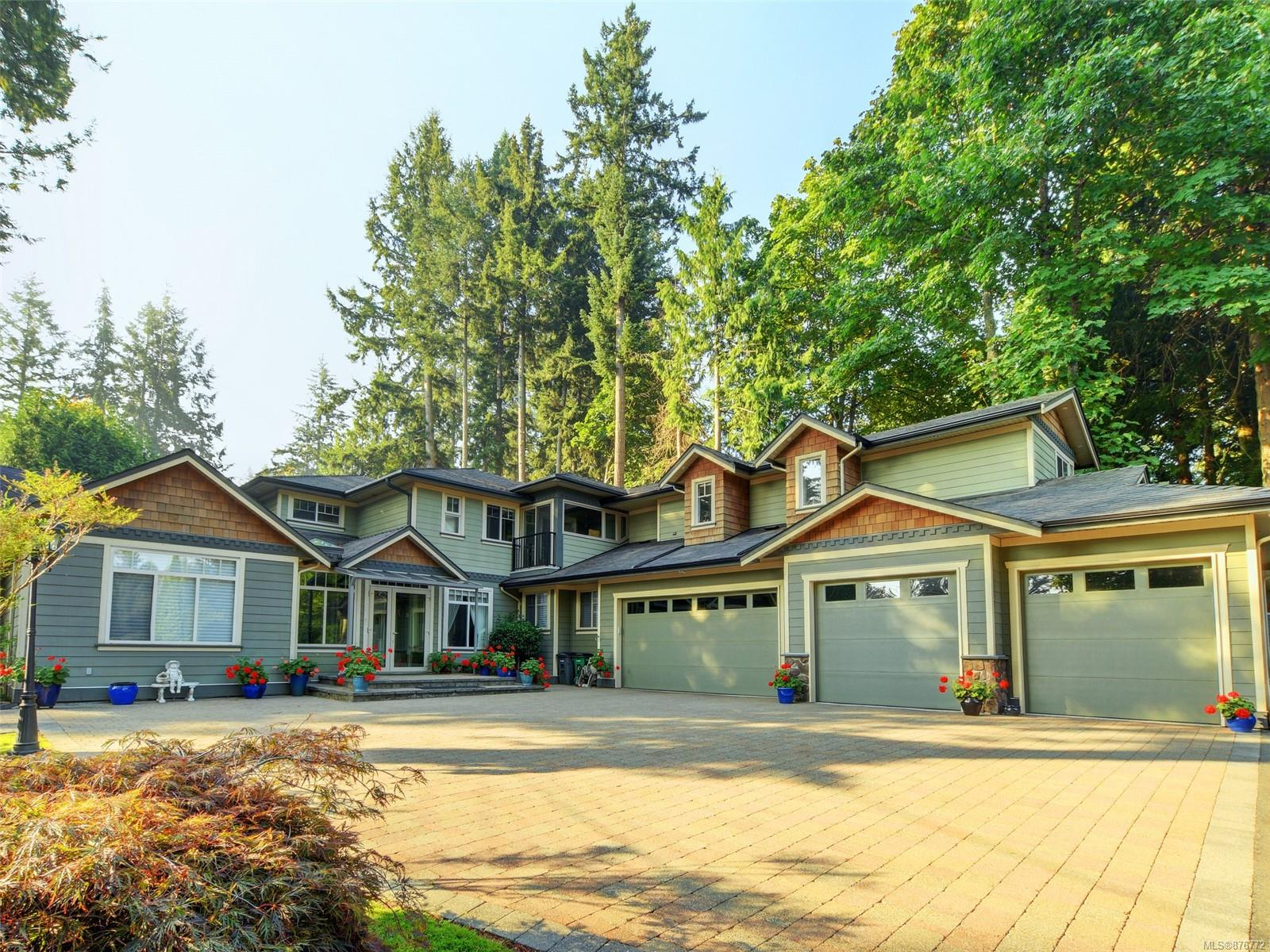 CORDOVA BAY EXECUTIVE HOME-This 5 bedroom & 6 bathroom gated home boasts over 5000 sqft of living space & is abundant w/high-end features. You will find heated maple hardwood flooring, a large gourmet kitchen w/Miele & SubZero ss appliances, granite countertops, & beautiful white cabinetry. Kitchen is connected to a stunning fountain room, providing a tranquil space for rest & relaxation. Main floor offers 2 large living/family rooms, office w/large book organizer, media room wired for a projector, & built-in surround sound system that can be enjoyed throughout the home. Upstairs has large 2 bedroom suite-w/separate entry-which can be included as an extension of the main house or kept as a detached suite. It has its own covered parking. Every bedroom has its own ensuite. Beautifully landscaped w/large patio for outdoor enjoyment. Home comes w/3 car garage which could easily function as a workshop. Situated nearby Elk lake, walking trails, golf courses, shopping, & all levels of school.