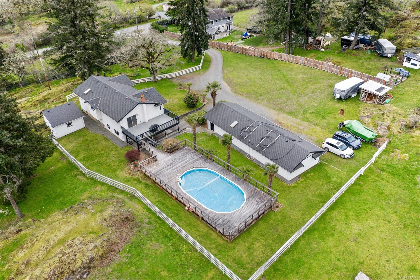 Rarely does the opportunity arise to own 6.98 acres of land this close to the city and all amenities. Welcome to 1916 Burnside Rd West, a sprawling estate like property proudly offered for the first time in over 65 years. Lovingly maintained house with 3 bedrooms and 1 bathroom upstairs, complete with rec room, additional bedroom and bathroom below. The massive 400 square foot west facing sundeck leads out to your very own swimming pool that captures all day sun. Beyond the pool you have the perfect view of the expansive field leading up to a unique Garry oak meadow that backs onto the world class Highland Pacific golf course. Bonus detached 1-bedroom farmhouse studio space and an incredible 750 square foot detached workshop currently set up for a wood worker. This one-of-a-kind offering is now available at a reduced price representing incredible value in today's real estate market. Book your private showing today.