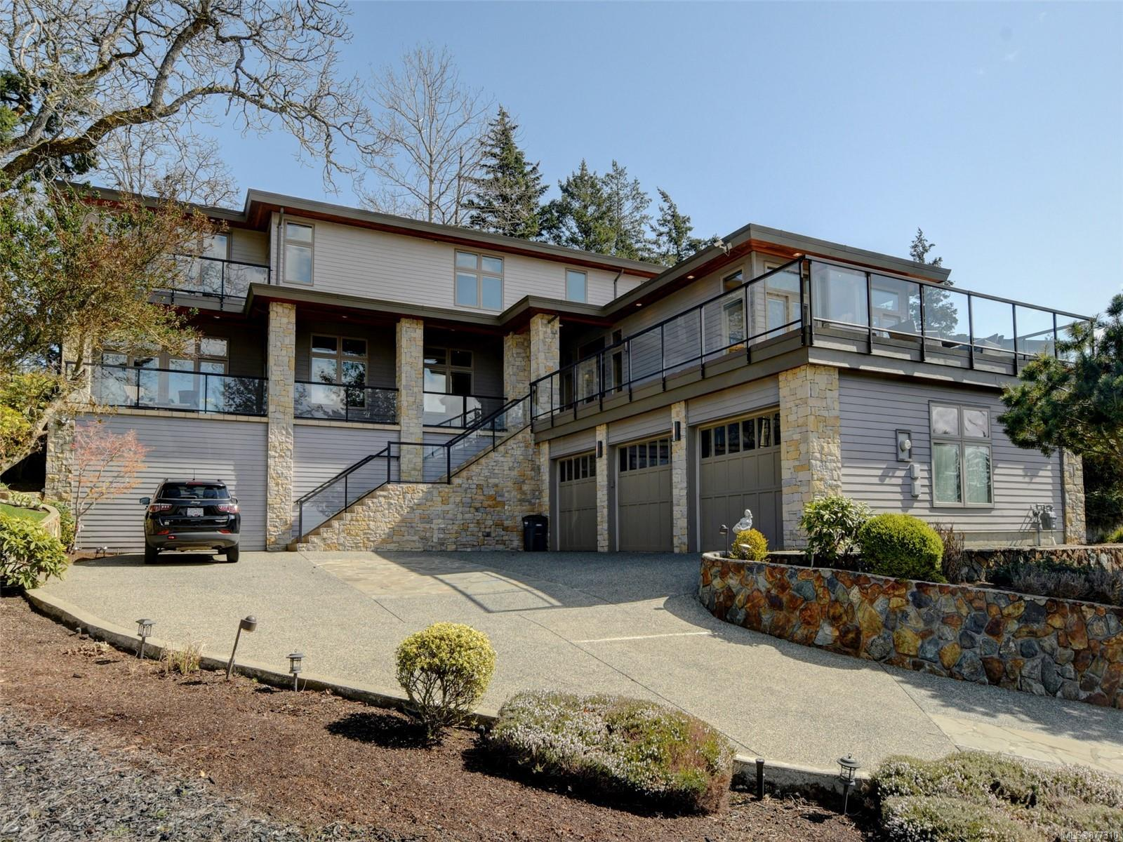 This architecturally designed home situated on a 0.55-acre lot offers over 7,386 SqFt with plenty of seating to soak in mountain, city & distance ocean view in sought-after Broadmead. Custom-built Luxurious home with impeccable quality in finishings and design, modern lighting, Elevator, 2-sided fireplace, radiant floor heating, built-in sound system, air exchange system, an abundance of windows to enjoy the views. The main level offers one guest room with ensuite, office, formal dining and living areas, an open-concept kitchen with adjacent family room opening to the backyard deck, Patio. Media room, Maple wood floors, electric remote blinds. Living space flows easily to extensive decks surrounded by beautifully maintained gardens, pond.  Upstairs offers 2 master suites &  3 bedrooms with ensuite.  the lower level features a Games room, Gym, Rec room, Steam room, triple garage. Prime location, close to Broadmead Village, Commonwealth, Elk/Beaver Lake. You'll surely be impressed!