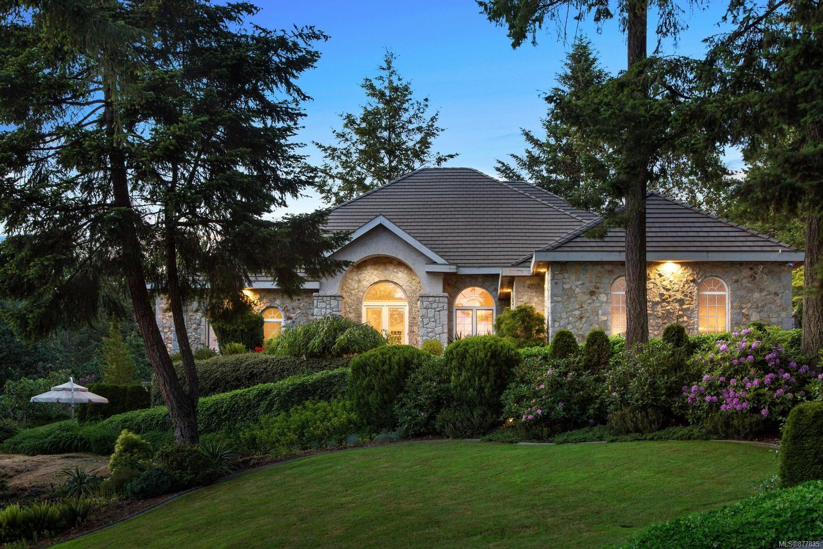 Escape to the prestigious Garden Gate Estates community. Custom built & the embodiment of grandeur & timeless beauty. Complete solitude with a beautiful privacy hedge & striking wrought iron gates. Quality is evident from roof tiles to granite cladding. Striking features such as vaulted ceilings, granite & bamboo floors, inset lighting, handsome built-ins & moldings showcase the elegance. 8000+sq ft with state of the art kitchen; inviting family rm, large DR & LR, lrg office, primary suite w/5pc bath +2 more bedrooms & baths. Lower level are 2 bedrooms & spa styled baths, wine cellar, movie theatre & large entertainment area. Enviable outdoor living, surrounded by a beautiful Garry Oak park with a private well for irrigation. 2.23 acre park-like property affords endless enjoyment, with mature trees, manicured gardens, expansive patio sections, tranquil gazebo & stunning stonework. Take advantage of nearby beaches, trails, Butchart Gardens & the world class amenities of Brentwood Bay.