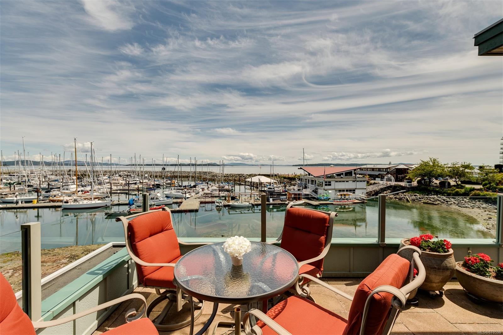 Fabulous One Level Waterfront Living! The Panoramic Ocean View to Mt Baker from all principal rooms is simply stunning. The location is unsurpassed. Looking to downsize from a large executive home without giving up any of the luxuries? Or wanting a fabulous seaside second home? Don't want to live with hundreds of other people? This exclusive building has only five suites for the most discerning owners. Downtown Sidney is a two block stroll. Tastefully melding all the luxuries of a fine home with all the conveniences of a condominium, the superbly executed layout makes it an easy move from a large home. Two bedrms, two bathrms, plus a den provide all the flexibility that you'll need. Beautiful open concept kitchen, dining and living room all warmed by the three way gas fireplace. From the granite counters in the designer kitchen to the lovely slate floors with infloor radiant heat, the finishing is top quality throughout. Two underground parking spaces accessed by the elevator. Pets ok.