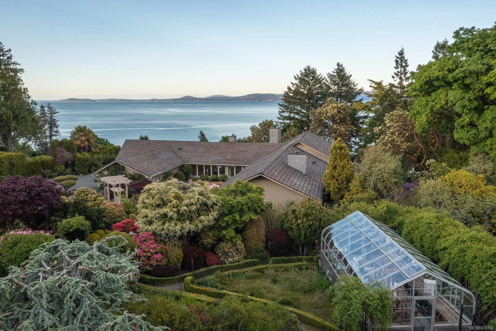 Welcome to 2282 Arbutus Road, a stunning estate-like property situated on 1.16-acres with sweeping ocean views of Haro Strait and the San Juan Islands. This meticulously landscaped property feels like a private retreat tucked away from the hustle and bustle of the city. Beautiful mature gardens create a sense of peace and tranquility as you pull up to this luxurious home. Built to the highest of standards, over 8000sq ft of living space is at your fingertips. Walls of windows allow the natural light to flow throughout the space, creating a feeling that can't be beat. Over 2900 sq ft of deck and covered patio space allow for year-round enjoyment. With a list of features too lengthy to list including a complete renovation top to bottom in 2001, not to be missed is the great room, wet bar, formal living room, family room w/vaulted ceilings, 3 water features, & greenhouse. Located a stone's throw to some of Victoria's best beaches, UVic, Cadboro Bay, & 15 mins to downtown Victoria.