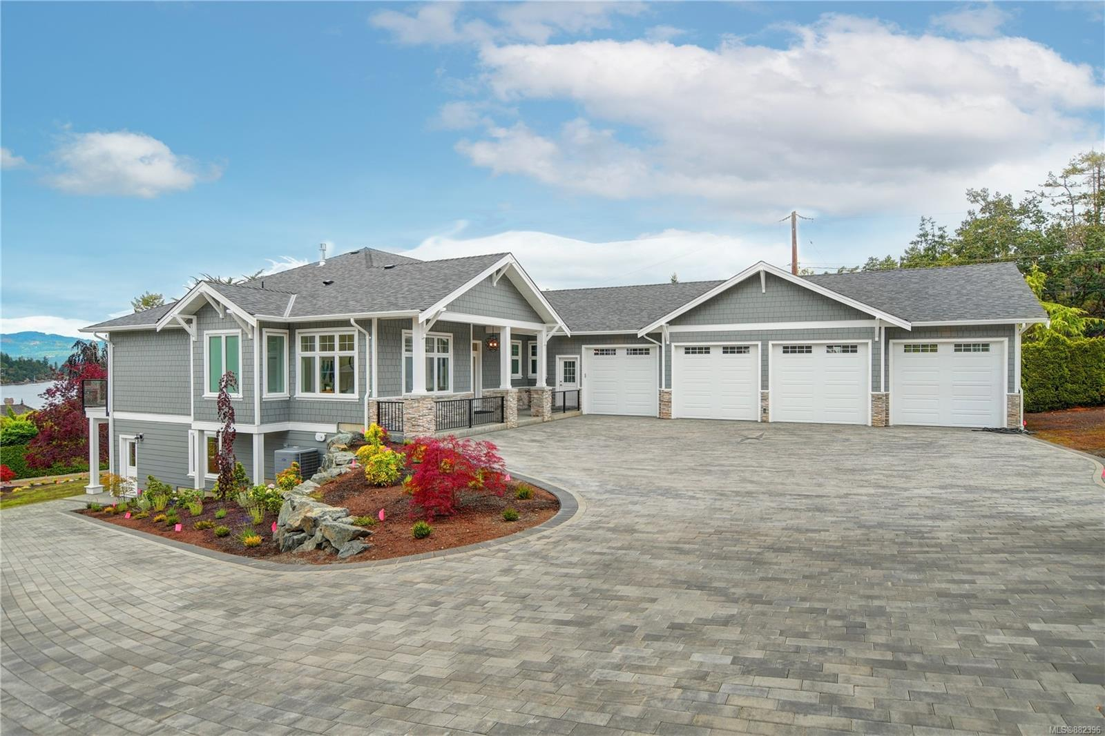 """Beautiful new home with  ocean views in desirable Deep Cove! Rarely does an opportunity to purchase a very special residence on .51 of an acre, with  SW exposure and your own beach access via legal easement become available. Enjoy relaxation from dawn to dusk from the terrace, while watching breathtaking sunsets and marine life including herons, eagles and whales. This luxurious home offers an open concept plan with oak wide plank engineered flooring, 10 FT. coffered ceilings and floor to ceiling windows creating a light and spacious atmosphere. The main floor has an elegant great room, gourmet kitchen, three bedrooms and three bathrooms including the master suite. On the lower floor you will find nine foot ceilings, a guest suite and large recreation room with sliding patio doors for everyone to enjoy. A bonus is a """"wow"""" spacious four car garage. GST included."""