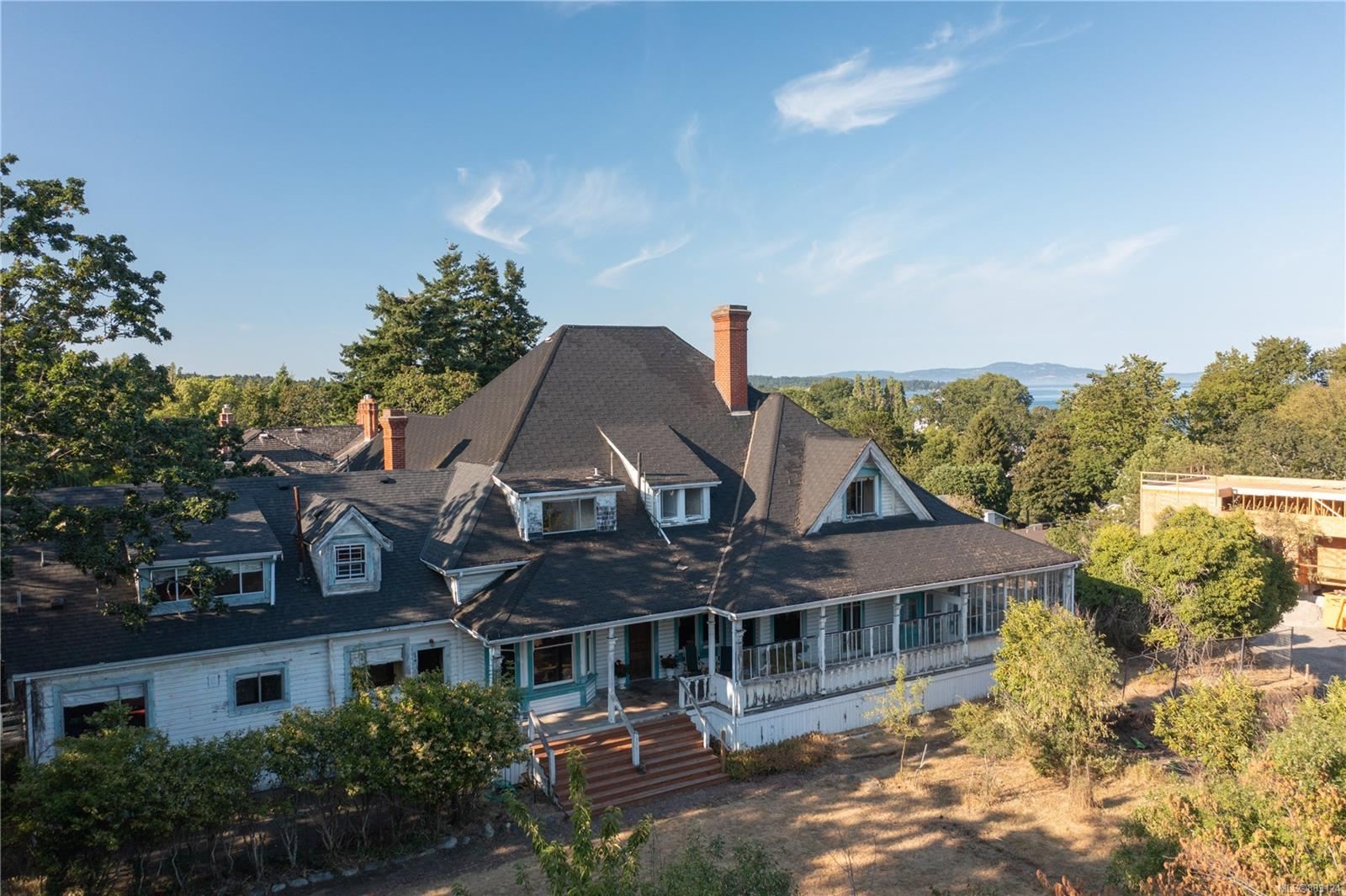 """A rare opportunity to take a piece of history and make it your own. Available for the first time in more than 40 years, 1587-1595 York Pl is considered to be one of the most significant surviving historic properties in Oak Bay. """"Annandale"""" was designed by late architect John G. Tiarks for Sir Charles Hibbert Tupper, son of Sir Charles Tupper, the Father of Confederation. Stunning original rock walls constructed of granite set the tone for this show stopping property. This custom-home consisting of over 7,300 sqft is dripping with history, whimsy, & opportunity. The property is a legal non-conforming Duplex, and has potential for subdivision (buyer to verify). This grand & gracious home is located on one of Oak Bay's most desirable no-through streets in an unbeatable location, mere steps from Oak Bay Avenue and amazing restaurants, a short distance to the beach and exceptional schools, Oak Bay Marina, and Victoria Golf Club. Don't wait on this truly unique opportunity."""