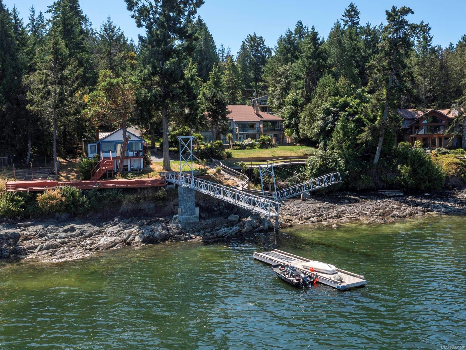 UNIQUE & RARE OCEANFRONT OFFERING!! 2 titled oceanfront properties (2+acres) consisting of a main house and guest cottage, private moorage, inground heated pool...perfect for those looking to create the ultimate family compound! Main house renovated in 2020 offering engineered hardwood throughout. 2 chef-inspired kitchens perfect for entertaining...granite counters, stainless steel appliances & 2 natural gas cooktops. Main floor principal bedroom with ensuite that overlooks private courtyard. 3 spacious bedrooms on the lower level, each with walkout to patio and pool. Main house has over 3000 sq ft of oceanfront deck/patio space...you are going to love entertaining here! Oceanfront guest cottage is original and full of charm. The perfect 1 bedroom/1 bath open layout offering over 1300 sq ft of oceanfront deck and patio space. New dock (8'x40') & aluminium gangway in 2020 is a boaters dream! Stairs down to the water offer great beach combing at low tide & a lovely launch of your kayak