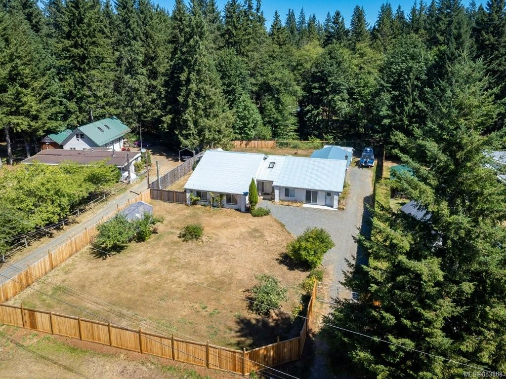 170 ft of low bank riverfront with 2+ acres – a beautiful 1700 sq ft rancher with an attached 1,000+ sq ft suite – An exceptional offering on one of the finest salmon and trout rivers on the east coast of the Island. This very well laid out and maintained home offers a huge Master bedroom, an open plan Kitchen/dining area, a large comfortable Living room with its cosy and efficient woodstove + sunroom. The attached suite is also spacious and inviting with a loft bonus room and separate entrance. The superb river frontage is accessed through both woodland and a lovely pasture down to the gazebo overlooking the river, with one of its finest swimming holes just a short walk to the south. Also included is a covered three bay for boat and RV storage, a large separate boat tent and a 2 bay garage/workshop. This excellent property is just 10 minutes to Saratoga Beach and the marina and just 30 minutes to both Campbell River to the north and Courtenay/Comox to the south.