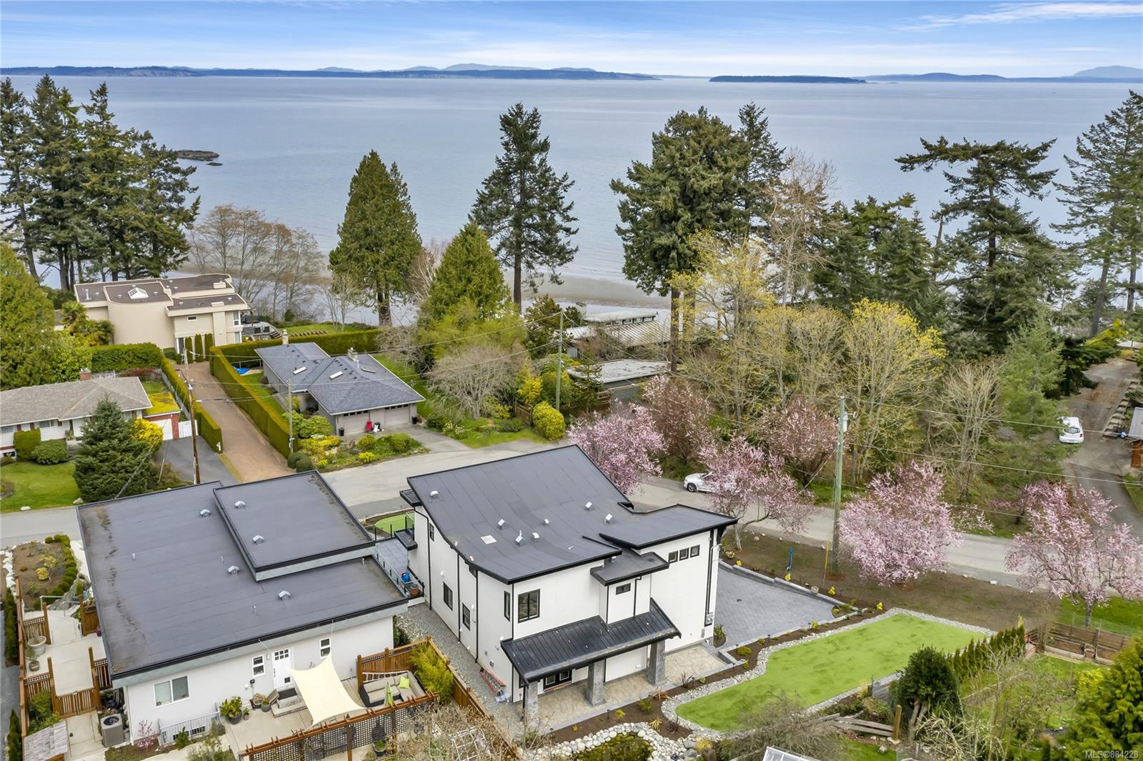 PRICE Improved! Incredible new build in stunning Cordova Bay! Located on a quiet cul-de-sac, this gorgeous homes is located on a corner lot with partial ocean views. Master features an enormous walk in closet, waterfall shower, and soaker tub surrounded by high end finishings and tasteful flooring throughout. Dual ovens, gas cooktop, and high gloss granite flooring await you in the spacious chef's kitchen, and a breathtaking patio extends off the main floor with enough space to host the neighbourhood! Other features include a gas fireplace, high end appliances, and decorative light fixtures. Downstairs is your playground, with a media room that's sure to impress! Nestled in a neighbourhood of lovely family homes the outdoor offerings are just as luxurious, with manicured landscaping, water features, and a spacious extra wide garage. Close to one of the best waterfront beaches in Victoria, and amenities in Cordova Bay and Broadmead, this home is an absolute island gem!