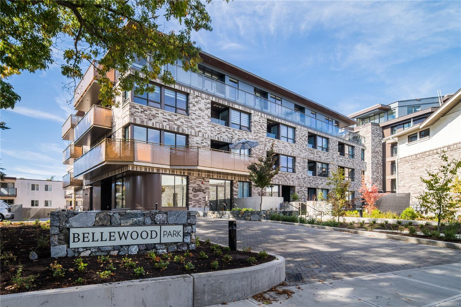 Welcome to the Bellewood Park PH nestled amongst large heritage Garry oaks on 2 acres of parkland in the historic Rockland neighbourhood. This 2 bedroom, 2.5 bathroom top floor corner condo boasts over 1600sqft of living space by award-winning Cascadia Architects & Zebra Design. From the foyer, light floods in from triple-glazed windows into a spacious open floorplan of overheight ceilings, rich wood flooring & light palettes. The chef's kitchen features appliances by Wolf, Fisher-Paykel, and Blomberg, a wine fridge located at the built-in dry bar, & waterfall quartz countertops lightened by the skylights above. Across you'll find the dining and living space with a large cascading wall unit with gas fireplace and TV. Both spacious bedrooms feature ensuites with heated flooring and walk-in closets. This suite also includes extra office space and powder room for guests. Step out onto the wrap-around balcony and enjoy unobstructed views of sunsets. 3 PARKING SPACES INCLUDED.