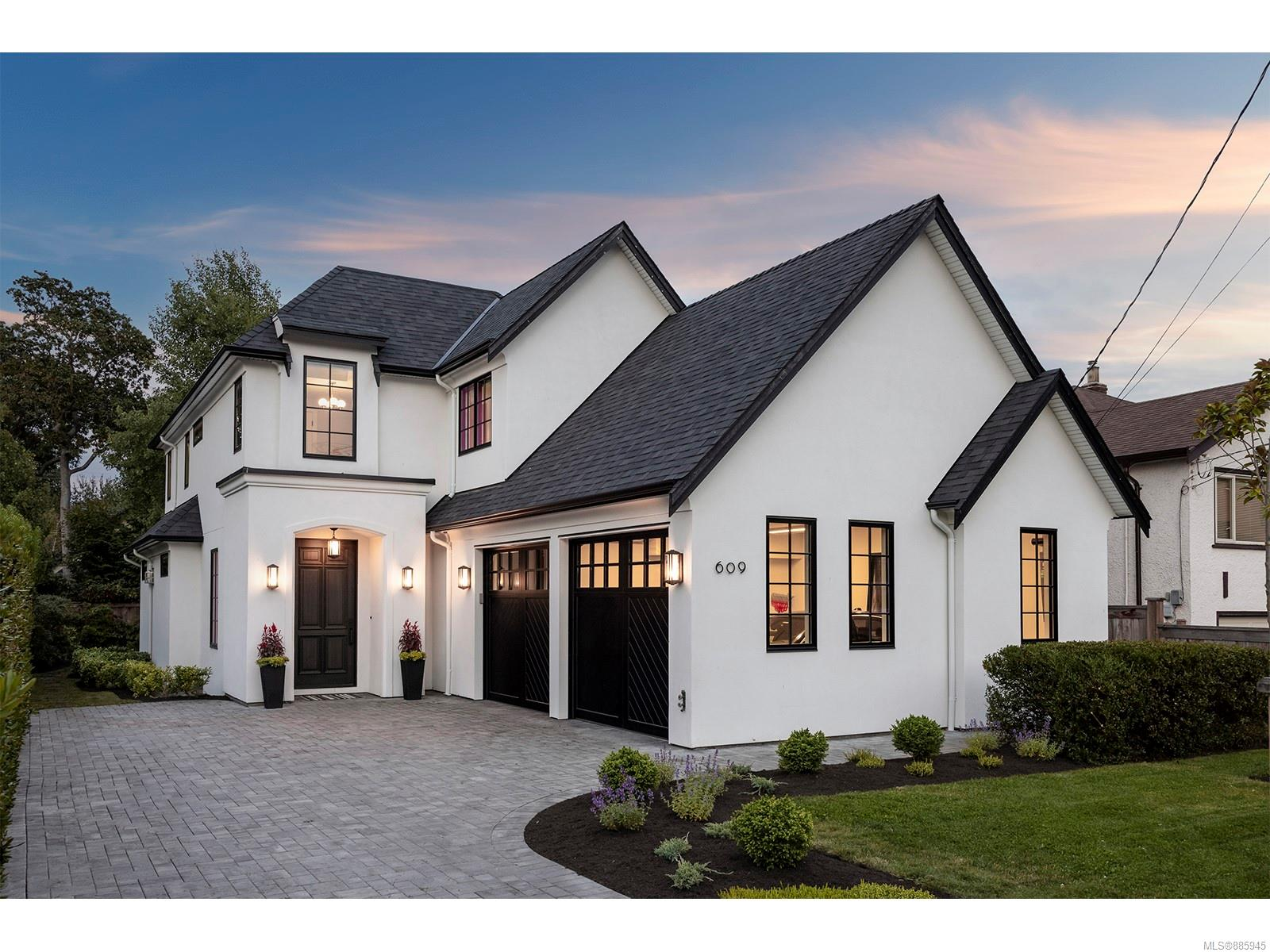 Gorgeous South Oak Bay home in an upscale/highly sought-after neighbourhood just steps from the ocean! This like-new home blends a European style with modern lines, and an airy/open design that features custom herringbone HW floors, heated Carrera marble tiles, Pella windows, gourmet 2-tone chef's kitchen w/10' island, huge windows, wired for Control4, over-height doors & generous living/entertaining spaces with FP and built-ins! Large laundry/mud room on main & custom built-ins/storage/closets throughout the home. Gorgeous master suite boasts a private terrace, marble fireplace & luxurious ensuite bath w/floor to ceiling Carerra marble. Two additional bedrooms upstairs, plus fully finished lower level, media room/games area, custom walnut wet bar, wine room & additional bedroom/bath. Easy care fenced & landscaped property features private patio w/gas Fireplace....steps from the beach & close to the best schools & all amenities, Oak Bay Village, Golfing and recreation!