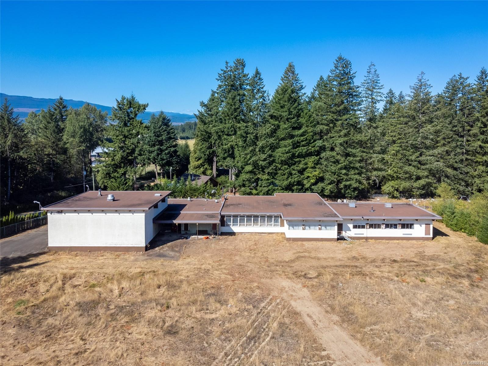 """1160 sqft 2 bedroom and 2 bathroom residence on 4 acres with a +/- 15,000 sqft ft building. This property is the old Black Creek Elementary School grounds which now include the home and a """"dug pond"""". The school building """"appears"""" to be in good condition including the gymnasium, main classrooms, office etc. The home was moved onto the property approximately 12 years ago but remains vacant and in a basic condition with no known septic, connected power or water.  The septic system for the school is unknown, however there is an RD water connection together with a shallow well. This property is being sold """"As-is where-is"""" with no representation from the owner company. The A-1 zoning allows for Assembly and or Institutional use but the RD may allow other activities upon request and application. The Zoning also allows for one single family dwelling. This is excellent value based upon the replacement costs associated with a +/- 15,000 squ ft building, the 4 acres, dwelling and location."""