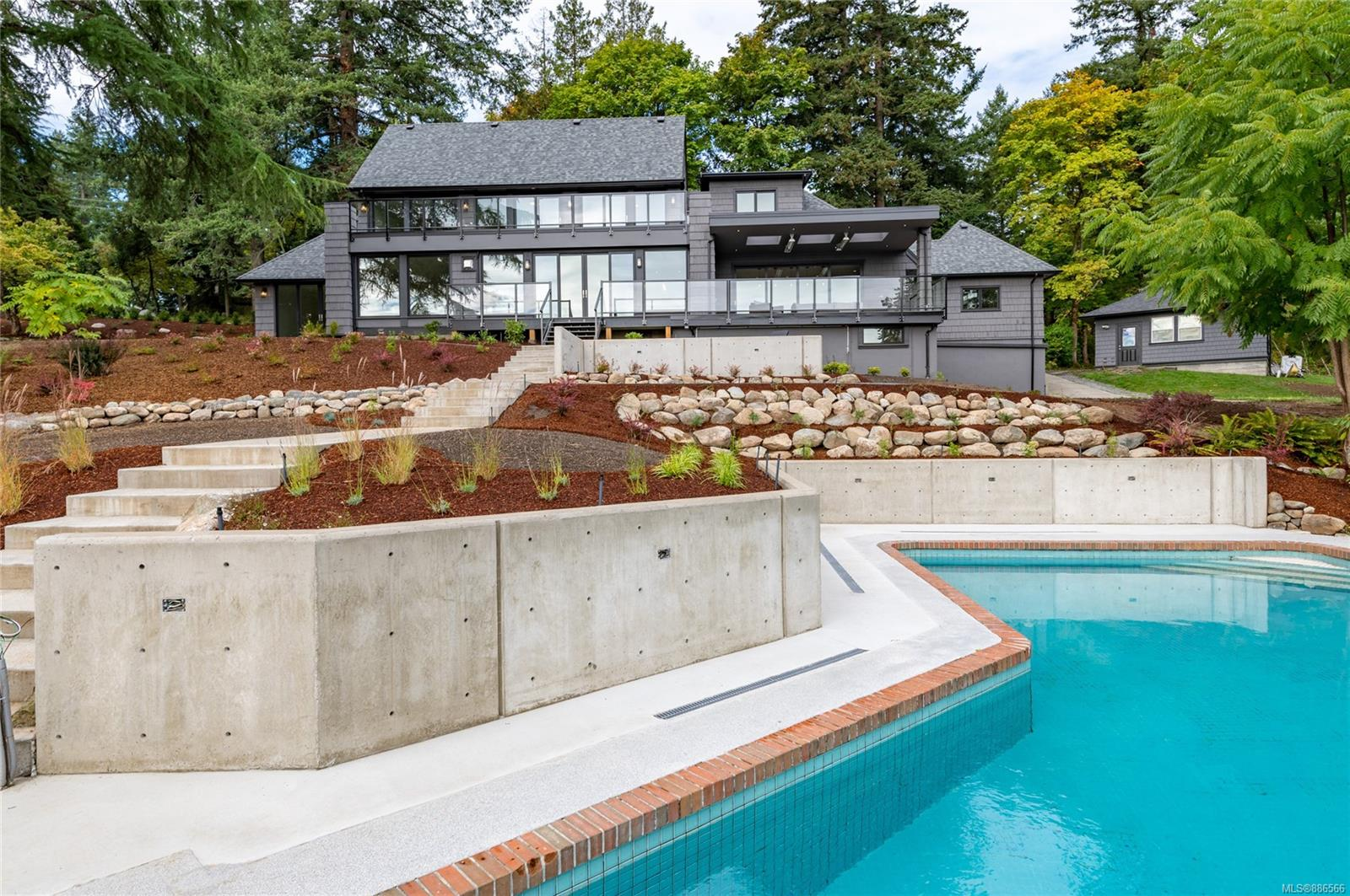 """This spectacular 2.85 acre estate is located just 20 minutes from downtown Victoria. Featuring a renovated guest cottage, tennis court and outdoor pool, the property offers stunning views of the ocean and Mt. Baker. A rare opportunity for a modern country lifestyle close to the city! A stunning renovation of the property has just been completed. Virtually a  brand new home offering 4800 square feet of open plan family living that allows for views from all principle rooms.The stylish renovation has created a """"modern farmhouse"""" vibe while preserving and polishing the charming 1941 front facade. Modern rear facade embraces ocean views with large windows & numerous outdoor entertaining areas. The chef's kitchen has a 12-foot island, stone countertops, deluxe appliances & a huge foldaway glass door that leads to a covered and heated deck.Main floor media room, upstairs office and flex space,Basement suite & garage parking for 4 cars. Beautifully landscaped for easy outdoor living !"""