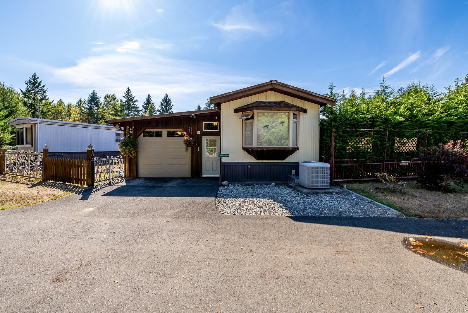 Welcome to the well-maintained, Saratoga Beach Mobile Home Park! This move-in ready unit is located in the highly sought after area on the Eastern Coast of Vancouver Island. Within close distance to the Oyster River, Saratoga Beach, a 9-hole golf course, grocery store, liquor store, and medical clinic - you are close to everything you need. Step inside and notice the ample cabinet and counter space in the kitchen with stainless steel appliances. Vaulted ceilings carry throughout the kitchen, dining room and into the living room which includes a big bay window to allow in optimal natural lighting. This unit features two comfortable bedrooms, with an additional third bedroom or den. A large connected garage or potential workshop with plenty of storage space. Bonus features include a heat pump with forced air, a large garage/workshop with extra storage, and a covered back deck overlooking the open common property.