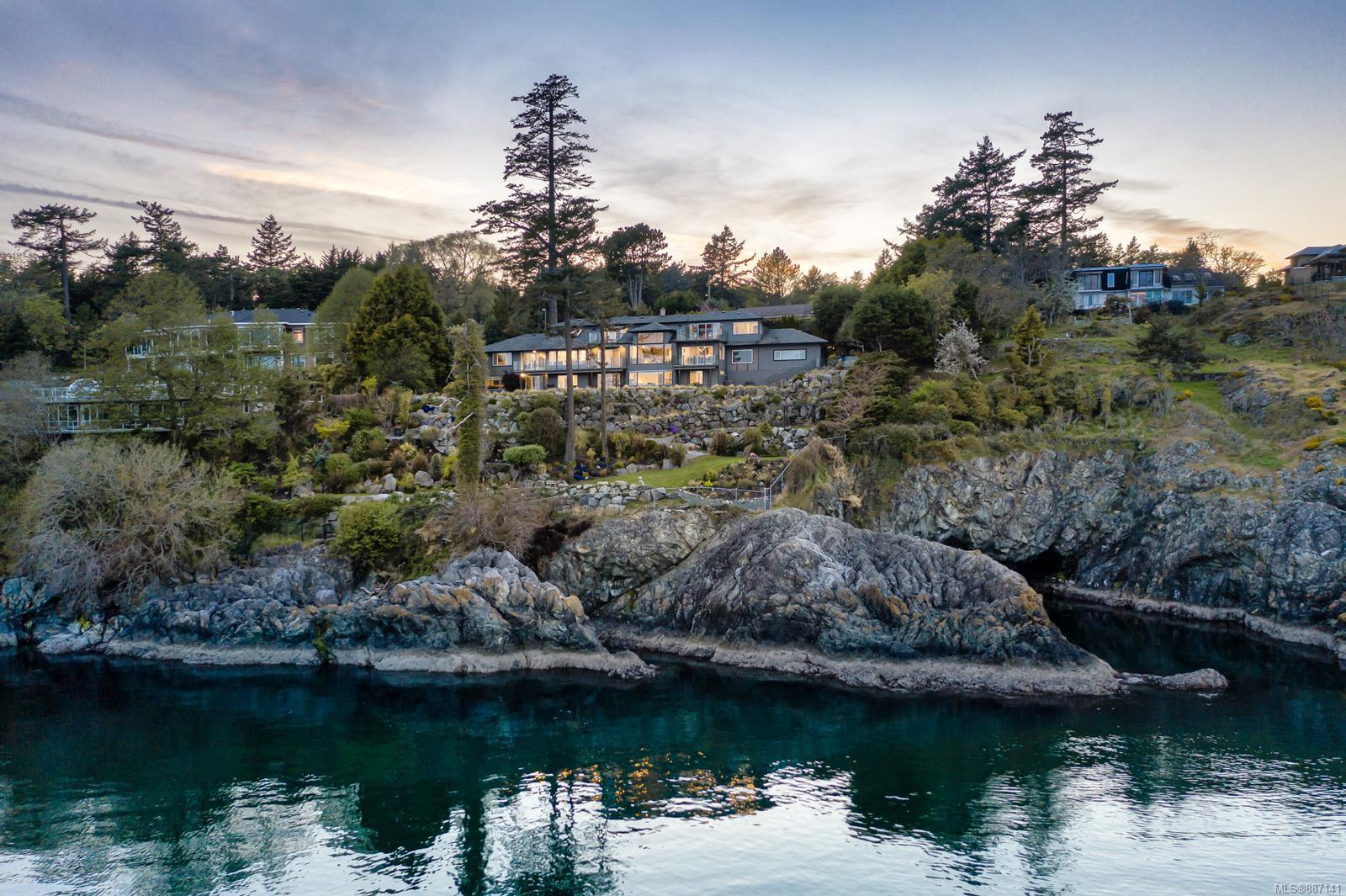 With one of the most spectacular views in all of Victoria, 4325 Gordon Head is an impressive estate, providing quintessential waterfront living. From the minute you arrive you'll be impressed by the gated entrance, cascading waterfall, manicured gardens, and total privacy. This family home affords panoramic ocean views from nearly every room and is perfect for entertaining. The spacious living and dining room offer floor to ceiling windows, a modern fireplace, and great flow to the intimate breakfast nook and family room. The decadent kitchen has quartz countertops, 2 breakfast bars, pantry, and SS appliances. Also on the main is the private nanny suite, with open concept living space, walk-in closet, and sizeable bathroom. Upstairs are 3 bedrooms including the primary suite with large closets, a deep soaker tub, and oversized shower. The lower level provides additional bedrooms (all with views), option for an office space with separate entrance, as well as an indoor hot tub and sauna.