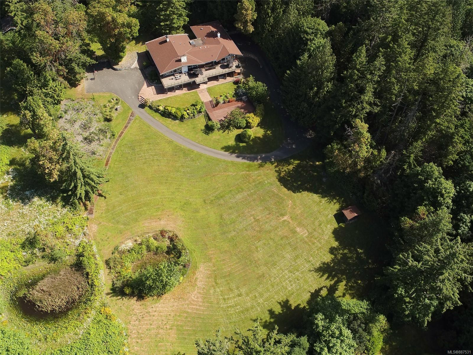 IMMEDIATE POSSESSION Exceptional 5 acre estate just 20 mins from downtown Victoria, yet a world away! Enjoy spectacular views across Elk Lake to the snowcapped Olympic Mountains. A south facing, gated, fenced & totally private sanctuary! Beautifully upgraded and renovated throughout. Almost 6000' of a flexible and open design offers perfect spaces for both family living and entertaining. Massive outdoor decking provides the perfect scene for summer gatherings. Chefs delight in the oversized gourmet kitchen with upgraded appliances and 6 burner stove. A spacious family room, casual eating area, formal living & dining areas round out the estate feel of this residence! Garage parking for 5 vehicles PLUS totally self-contained separate guest accommodation. Lots of additional parking space, a fig tree grove, sweeping lawns and so much more....just steps from Elk Lake, walking trails, parks and all amenities.  A true oasis!  Priced below assessed value!