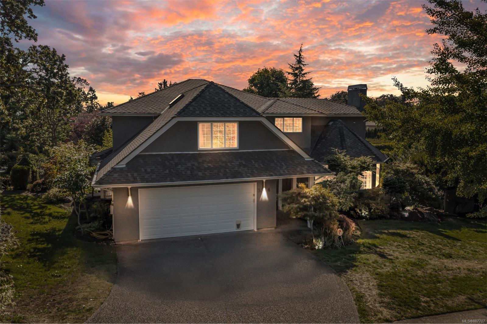 THREE-LEVELS and nearly 5,000 SFT FINISHED INTERIOR. Located in one of Oak Bay's most sought-after neighborhoods, UNIVERSITY WOODS! This 5 bed/5 bath executive home situated on 12,000+ sq/ft corner lot of mature shrubs, specimen trees & lush lawns, all irrigated by a 6-zone u/g sprinkler system. Main level offers a bright inviting kitchen with Eating Area, Family, Living, Dining, Office, and Laundry rooms. Enjoy a sizable SW-facing deck. Upper level has three good size bedrooms in addition to the spacious master suite. Lower level walk-out has a large additional living room, 1 bed plus den with 4 piece bathroom for in-laws. Big bonus above the garage offers a self-contained guest suite! Well maintained w/ quality improvements including Curupay solid wood flooring, heat pump, electric wall heaters & heated tile flooring. Double garage & crawlspace storage.Walking distance to St. Michael's University School, UVic, and Camosun College.