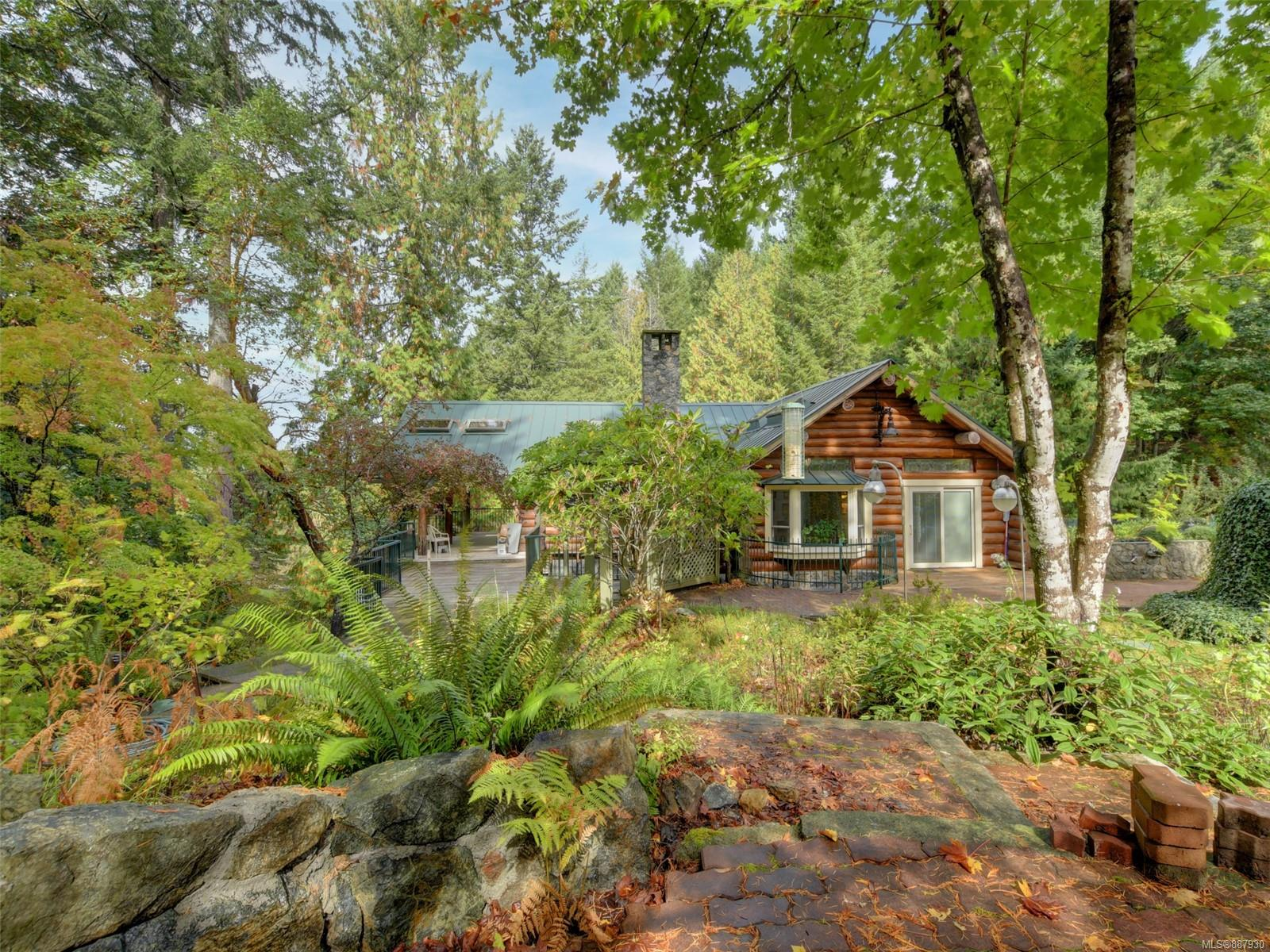 """ONE-OF-A-KIND! Custom Log Home on 54 Acres of Serene Paradise! Surrounded by Regional Parks, Lakes (Pease & Durrance) & Unlimited Walking Trails through Natural Forests outside your door. Exceptional craftsmanship & design offers: Large open concept Living-room, Kitchen & Dining area, 5 Bay windows, 1 Bow window, 20 unique leaded glass windows, solid oak 3/4"""" flooring, easy care tile & bright open areas to enjoy the quiet setting. The wrap around decks & patios with beautiful stonework & walls are an added asset for entertaining & enjoying the outdoors. This amazing property has so much to offer: your own hiking trails, roads to service your property, a seasonal stream that feeds into Pease Lake, nicely producing Artisian well, creek-fed Holding tanks for extra water & irrigation. Fully fenced Apple Orchard & Garden area for growing your own food (potential vineyard). All this & still only 8 min. to the Red Barn for groceries, 20 min. from Sidney, 25 min. to Victoria. *APPOINTMENT ONLY"""