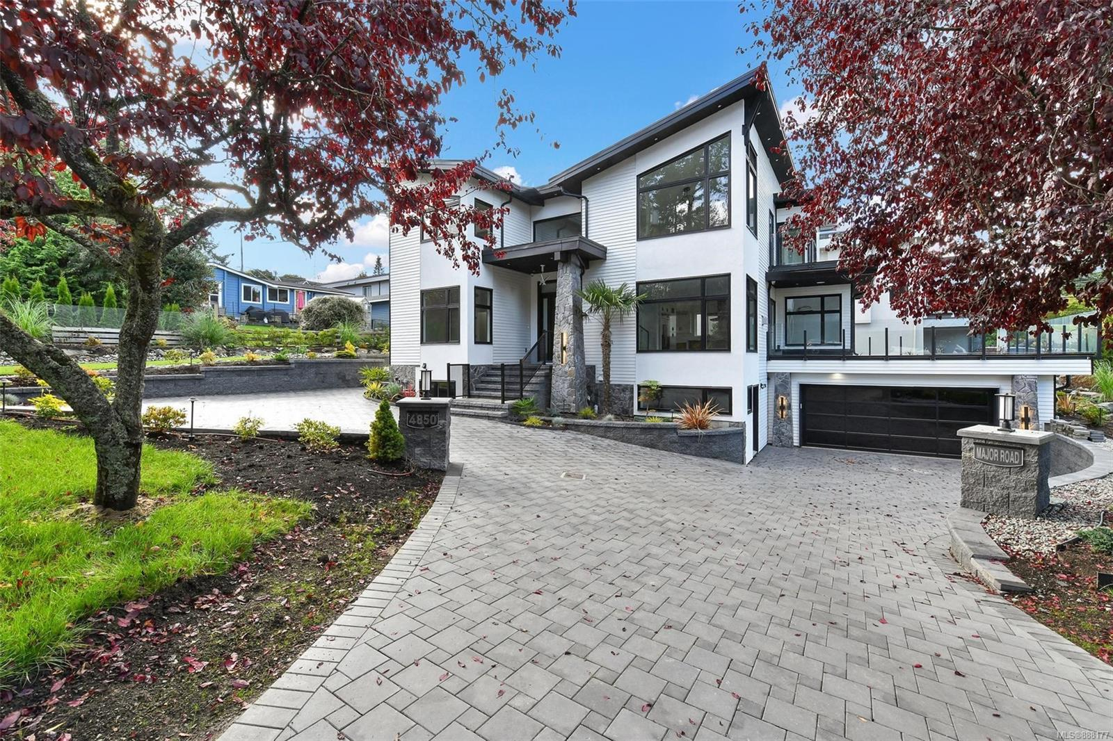 Welcome to 4850 Major Rd: the brand new ocean view home in Cordova Bay! On the main floor, you will find the gourmet kitchen with large island, high end KitchenAid appliances including oversize fridge& wine cellar,  garbage compactor, spicy kitchen, large bedroom/office with W.I.C and two living room/family room with gas fireplace. The top floor offers a beautiful Master retreat, 2 additional bedrooms with their own ensuites. Enjoy great views of the ocean, islands and mountains from master room and the balcony .Downstairs features a large media room, powder room, oversized double-car garage, and self-contained 1-bedroom suite. House also come with security camera system, heated tile flooring, water features, low maintain yards, high efficient furnace, hot water on demand, and central vacuum&AC unit roughed in. Great location in a quiet cul-de-sac: 7 mins walk distance to the D'Arcy Lane Beach, 4 mins drive to Claremont Secondary School and 12 mins drive to Uvic. Must see in Person!!!