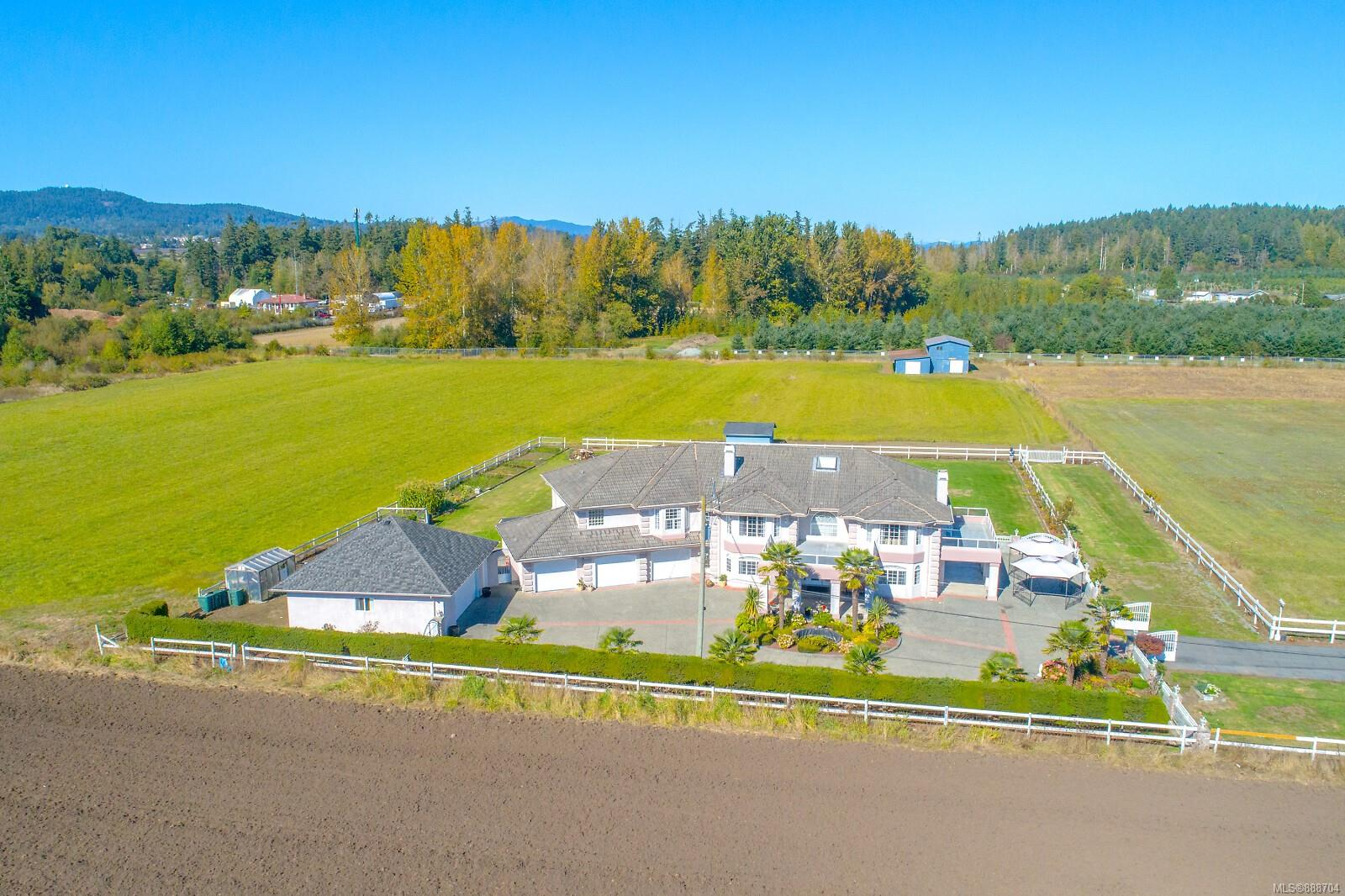 9.76 ACRE PRIVATE Estate Property in highly sought after Central Saanich.  It's hard to describe the feeling you'll get as you make your way home down the beautiful fruit tree & fence lined driveway. This 6 Bed 7 Bath 6327 SqFt property offers an opportunity that doesn't come along very often. Just under 10 acres of prime flat ALR. The lower level features a large rec room, guest bedroom, 4pce bath, wet bar, grand living room, additional bedroom and 5pce bath (Potential 1 bed suite). The 1000 SqFt 3 car garage will fit all the toys. On the upper level you'll find a grand family room, kitchen, dining room, separate living room, 4 beds including a large master bedroom w/5pce en-suite & walk-in closet. There's also a large detached 2 car garage/event room w/wet bar and 2 Pce bath. Top it off with a 2000 SqFt barn, chicken coop, full security system w/cameras, beautiful landscaping and you have one incredible property to call home. You don't want miss  this incredible buying opportunity.