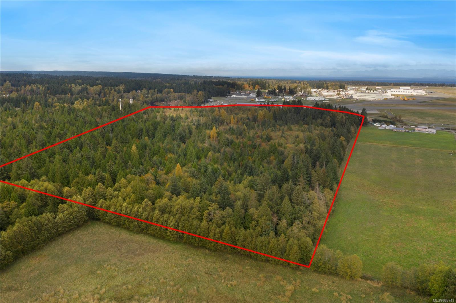 Spectacular 53.73 acre parcel of undeveloped land directly across from the Comox Valley Airport offers an incredible location & opportunity.  This level, south facing property sits in an area renowned for its good water and fertile land, resulting in one of the longest growing seasons on Vancouver Island.  It is situated adjacent to farmland on the south & east sides, to the west is the Town of Comox boundary. There is a substantial amount of merchantable timber currently on the property. Zoned RU-ALR.