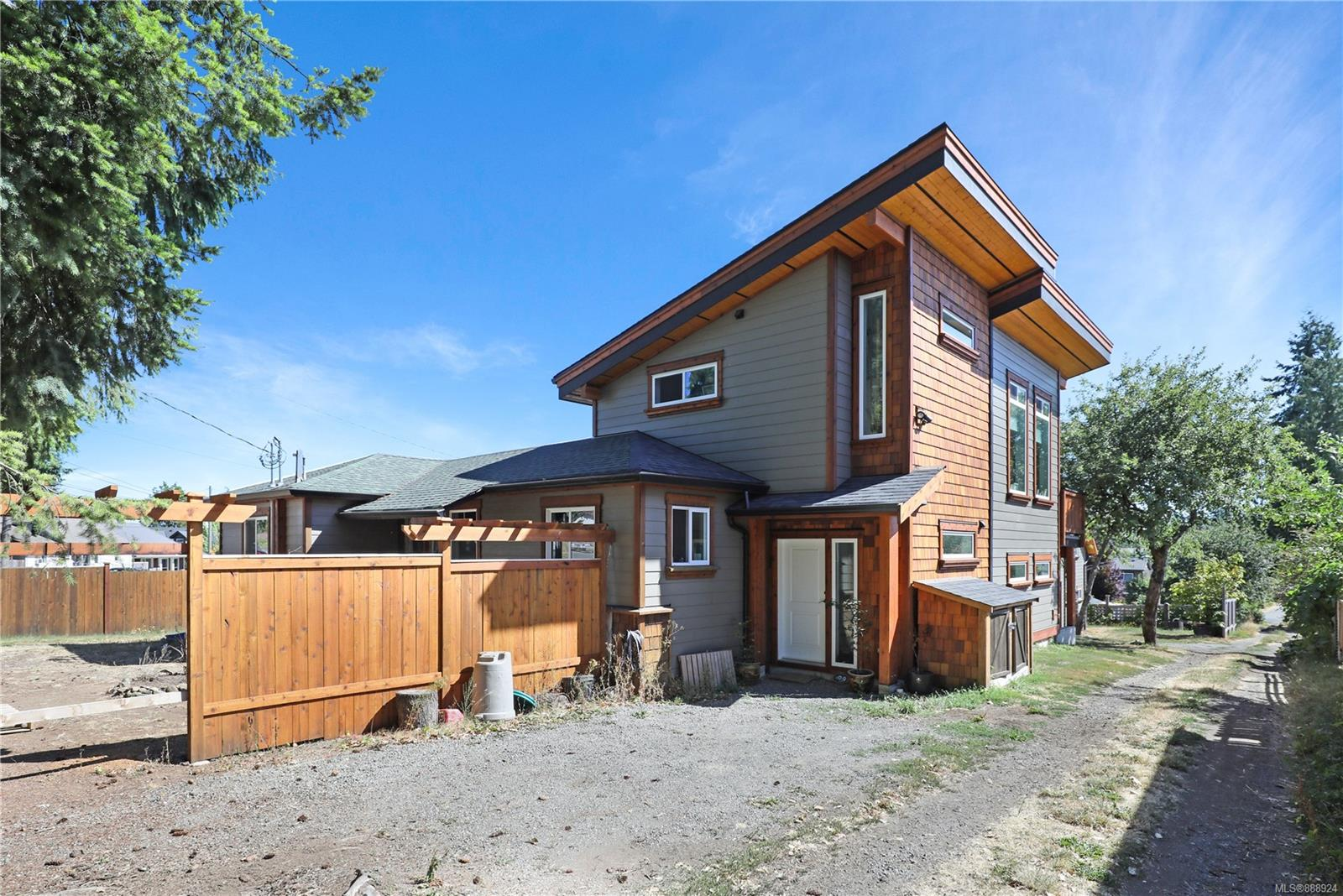 This unique property is full of revenue potential and situated in the heart of all that Cumberland has to offer. The core of the original house has its own entrance and laundry and features a full bathroom with a large tub, 2 bdrms and a den. An addition was added to the main house in 2019 featuring high ceilings, modern appliances and mountain views. A shared laundry connects two separate living areas in this new addition. The property also features a 1200 sq/ft secondary dwelling (ADU) with living space above a large garage. The features of this separately metered ADU include vaulted ceilings, modern appliances, outdoor shower, private driveway and custom details throughout. Exterior details on each building include hardy board siding, old growth reclaimed Red Cedar trim and striking black accents. Thought and care has been exercised at every step of the building process and the result is a stunning property with a cohesive feel and efficient layout. Your Cumberland lifestyle awaits!