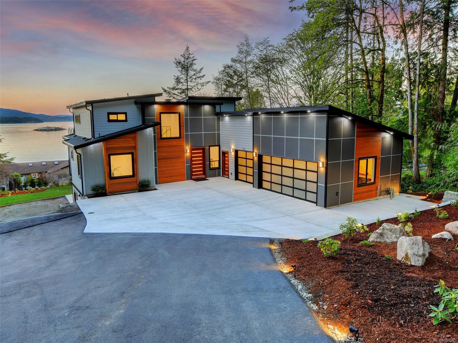 """Ocean and mountain views from all principal rooms. This new build offers over 4,900 square feet of modern-day living with EnerGuide rating of 69GJ/year.  The home has many great design features including in-floor radiant heat with 1.5"""" concrete(makes it sound proof to lower floor) throughout the main floor, engineered hardwood floors and a three-zone heat pump.  The main level offers an open concept living (over 11ft ceiling), dining and kitchen with a walk-in pantry, quartz countertops with high gloss cabinets and Monogram premium appliances including a natural gas stove plus the primary bedroom with a walk-in closet and five-piece ensuite. The main floor deck is roughed in and engineered for a hot tub, outdoor kitchen and heaters. A spacious backyard, patio and deck are perfect for entertaining and enjoying the outdoors. There is ample parking space for a boat or rv and a three-car garage with a big driveway.  Also includes a legal 2 bed in-law/nanny/guest suite. 2/5/10year warranty."""