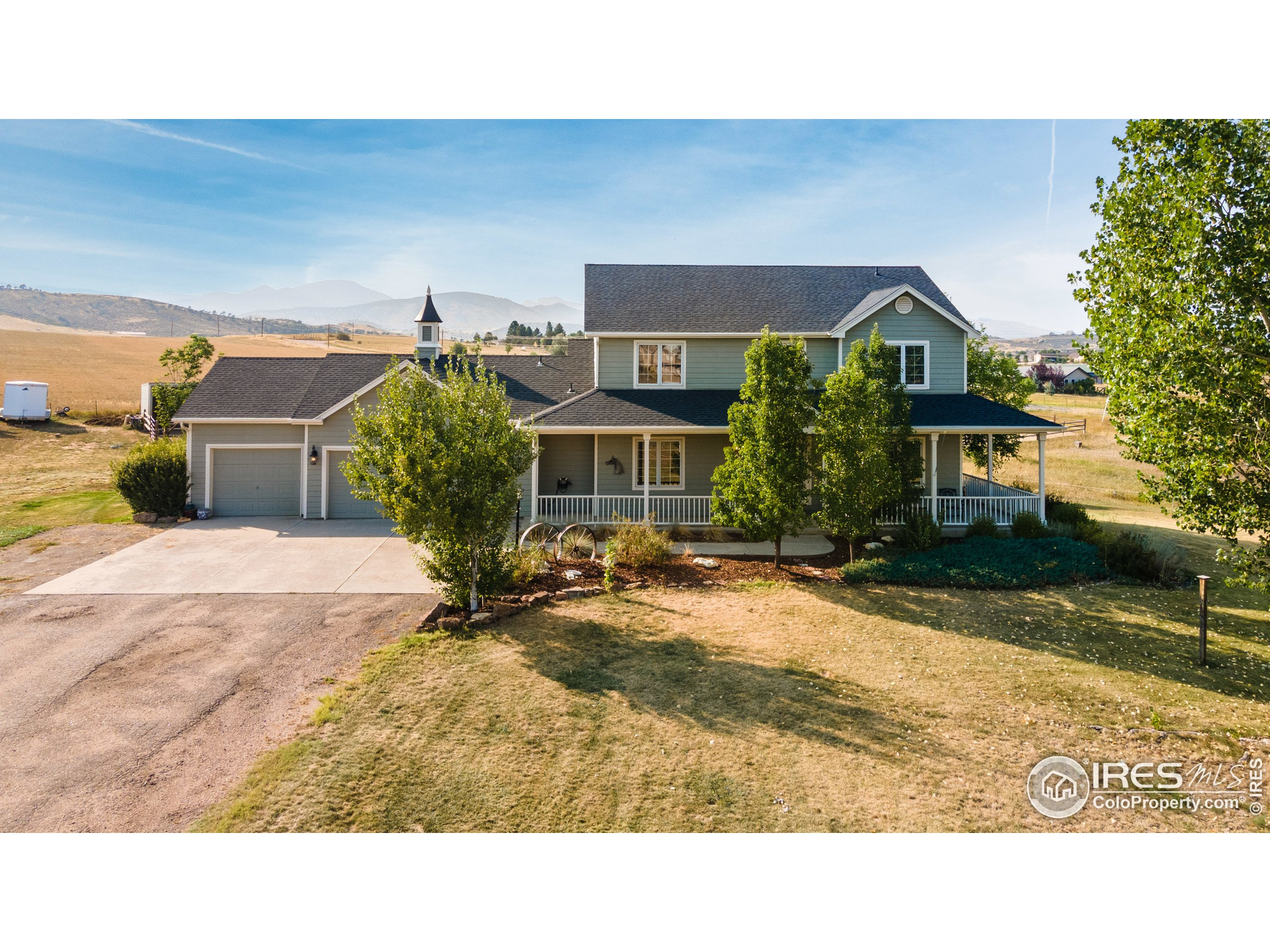 Perfect rural setting in west Loveland with panoramic views!  This gorgeous 2 story home is nearly 4,000 square feet and located at the base of the foothills on 3.36 acres of land.  Features of the home include 4 bedrooms, an office/study (or 5th bedroom) 3 bathrooms, 3 car garage, central air, family room with gas fireplace, eat in kitchen, kitchen island, ample kitchen cabinets and pantry, formal living and dining room, west facing deck, sprinkler system, wrap around porch and full unfinished basement.  Bring your animals as we have housing for them too.  By the way, have I mentioned the views?