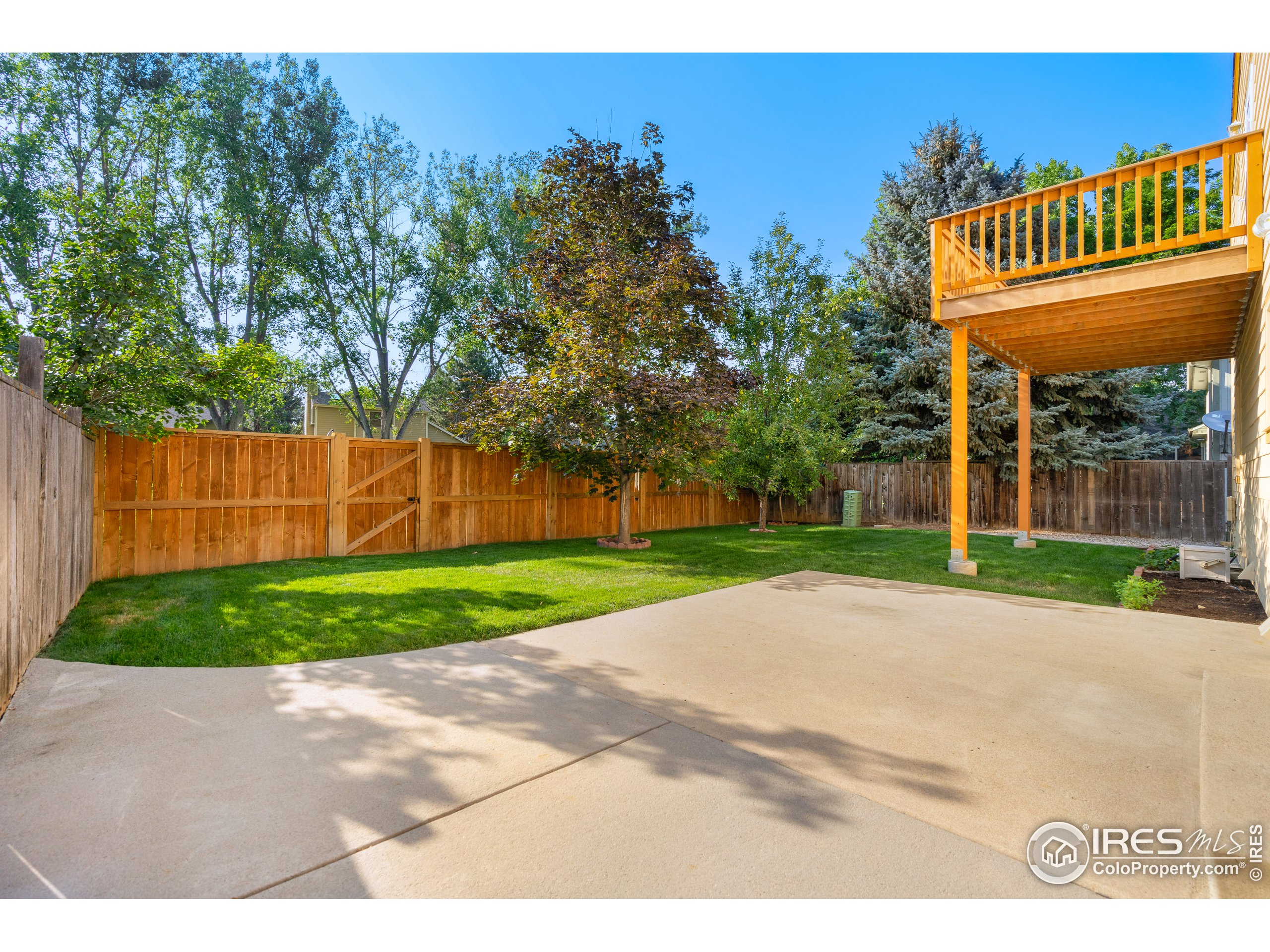 Fully Fenced yard with Large back patio and deck off Primary