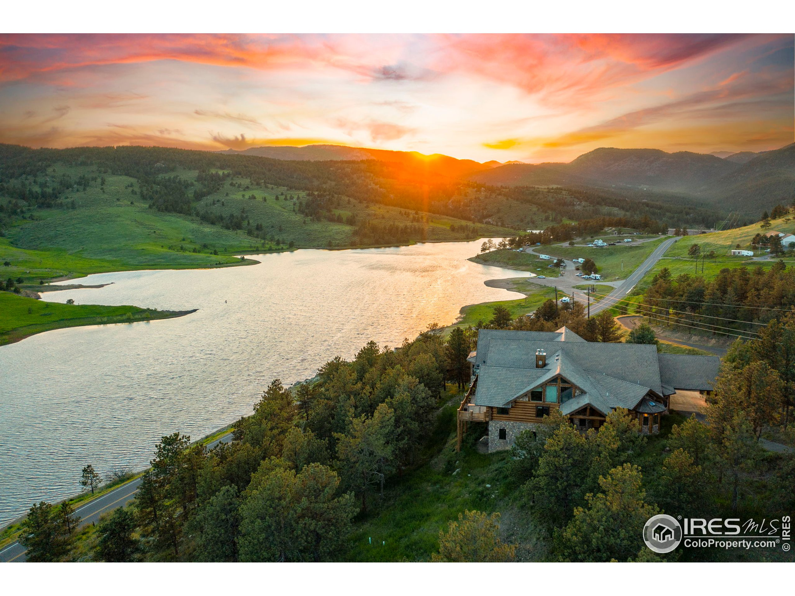 """Perfect for a corporate retreat, 2nd home or primary residence. NO HOA & NO METRO TAX. Work & Play from home in this 10,902 custom built luxury Log Home on Pinewood Reservoir. INCREDIBLE Rocky Mountain, valley & lake views. 20 mins to LVLD & roughly 45 minutes to Estes Park & RM National Park. Boat, hike, bike, ride, run, kayak & enjoy the Colorado lifestyle. 6 car finished garage w/ 8' doors. Gourmet kitchen, double islands, 48"""" range, built-in refrigerator/freezer, granite slab & 2 dining areas. Master suite w/ retreat, 2 walk-in closets & a 7-piece bath including a steam shower, jetted tub, bidet & urinal. Main floor laundry, front executive office, 30X20 main floor living room w/ stone wood burning fireplace + 2 additional beds (1 guest suit or in-law quarters). Upstairs features a loft + 2 more beds. 90% finished walk-out basement w/ rough in for a kitchenette or wet bar, bedroom w/ retreat, 3/4 bath & plenty of space for a billiard room."""