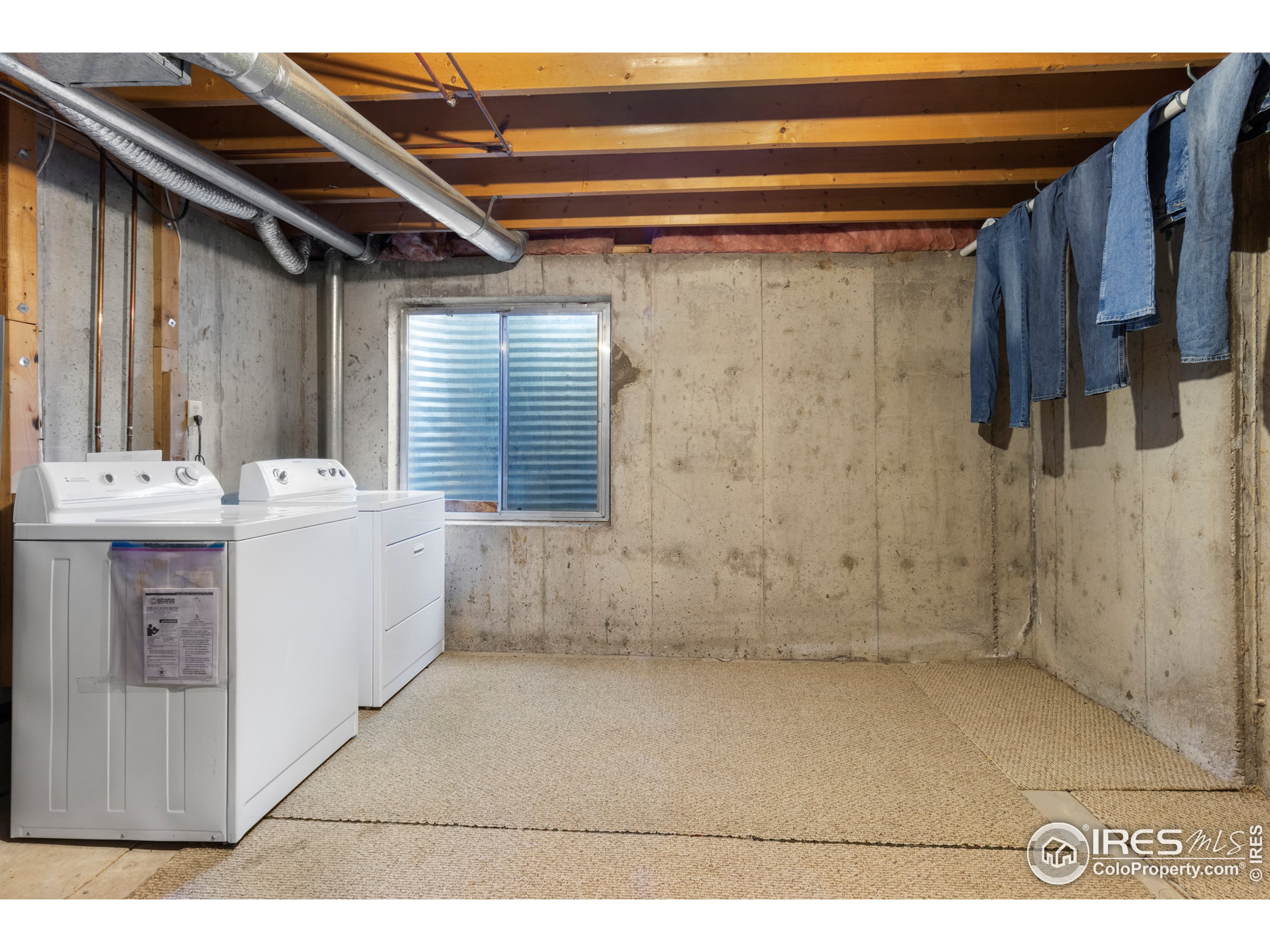 Laundry located in unfinished basement. Basement includes a rough-in and enough space for an additional room.