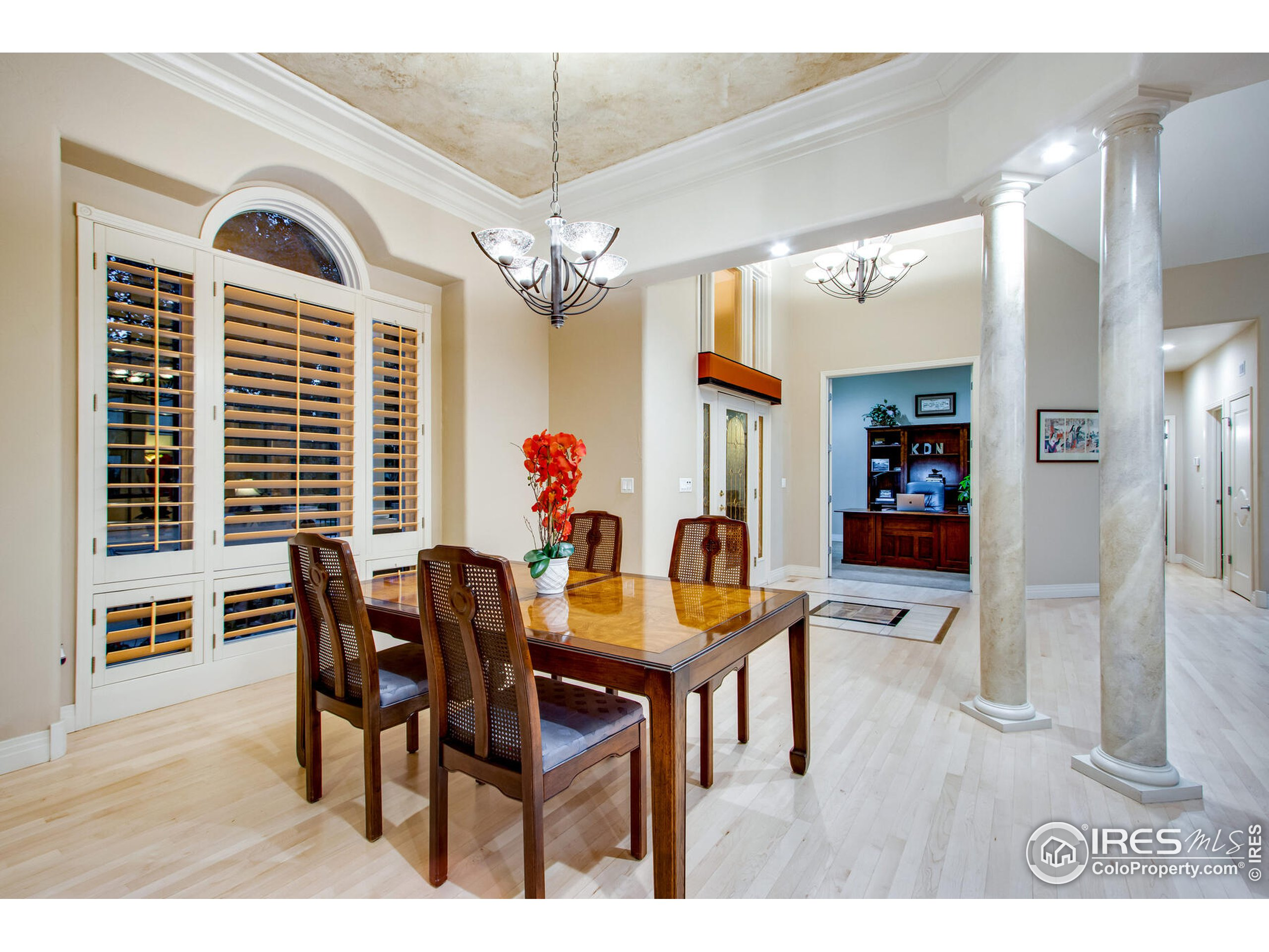 Spacious Open Dining Room with detailed faux design on ceiling and columns, and trey celings with crown molding