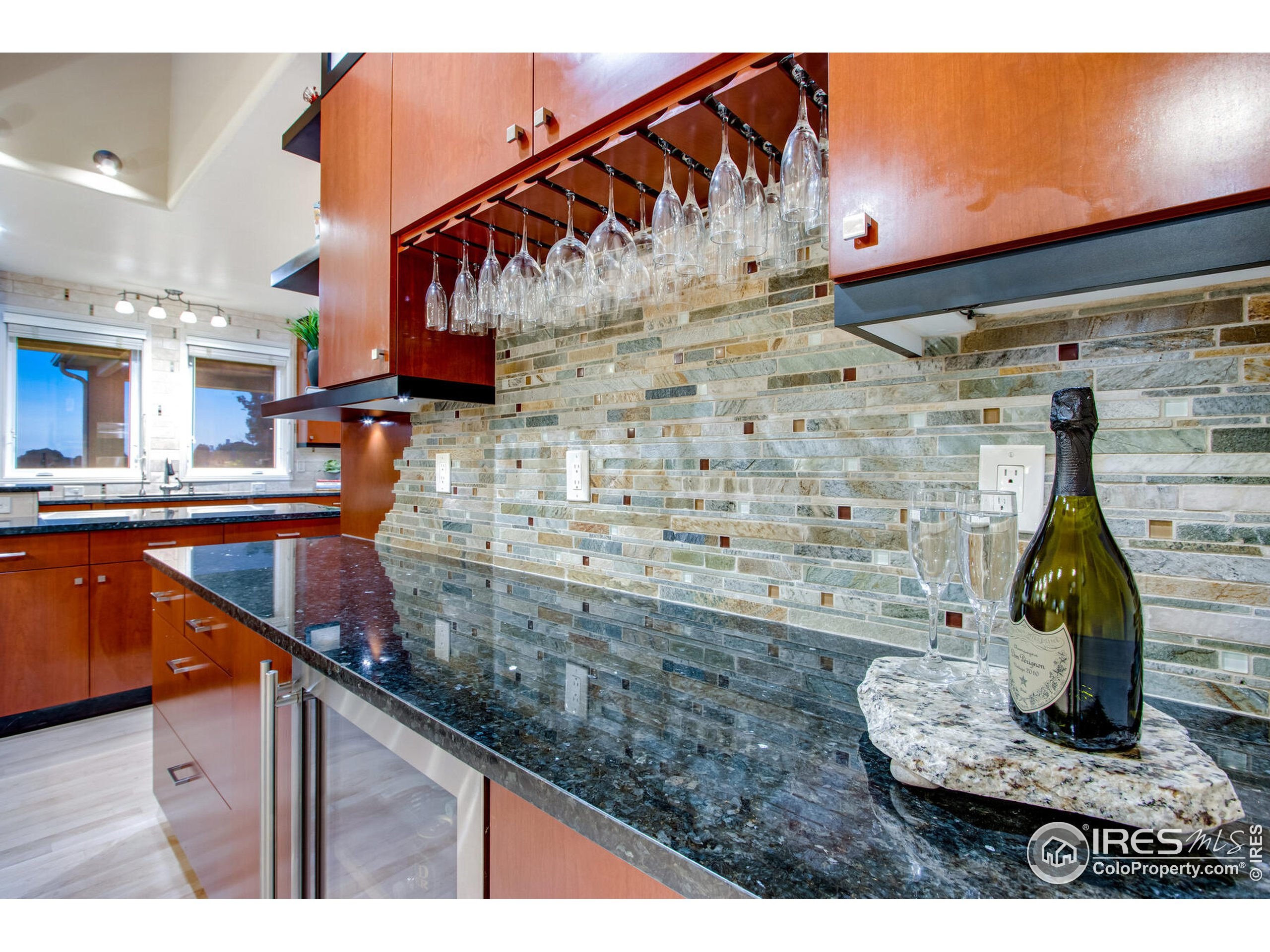 All Custom Cabinetry, Granite Countertops, Scotsman Ice Maker, Marvel Wine & Beverage Frig & undercounter LED lights throughout