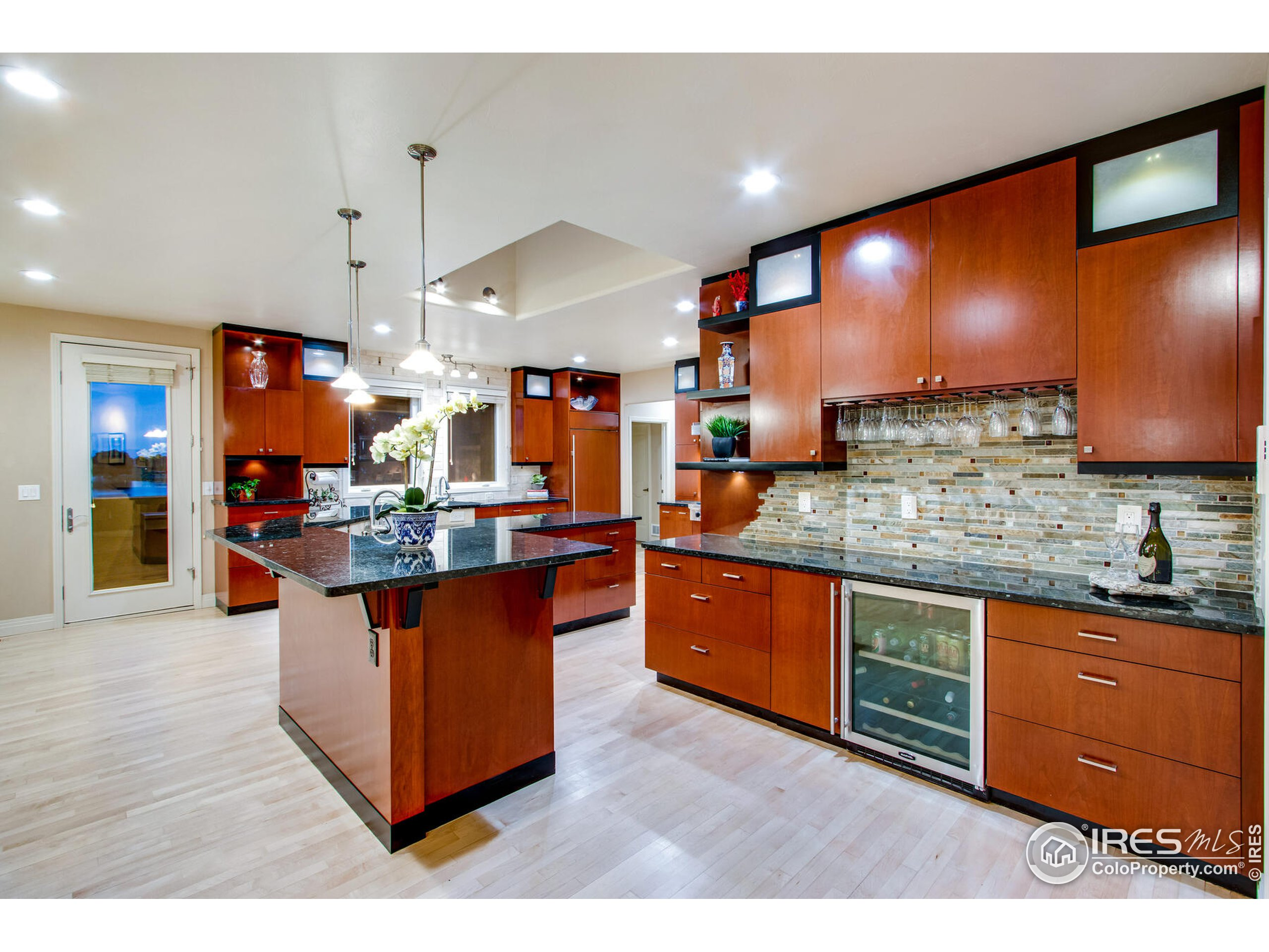 Well thought out wrap aroung Kitchen Island, with prep sink, second dishwasher, roll out shelves and designated bar area
